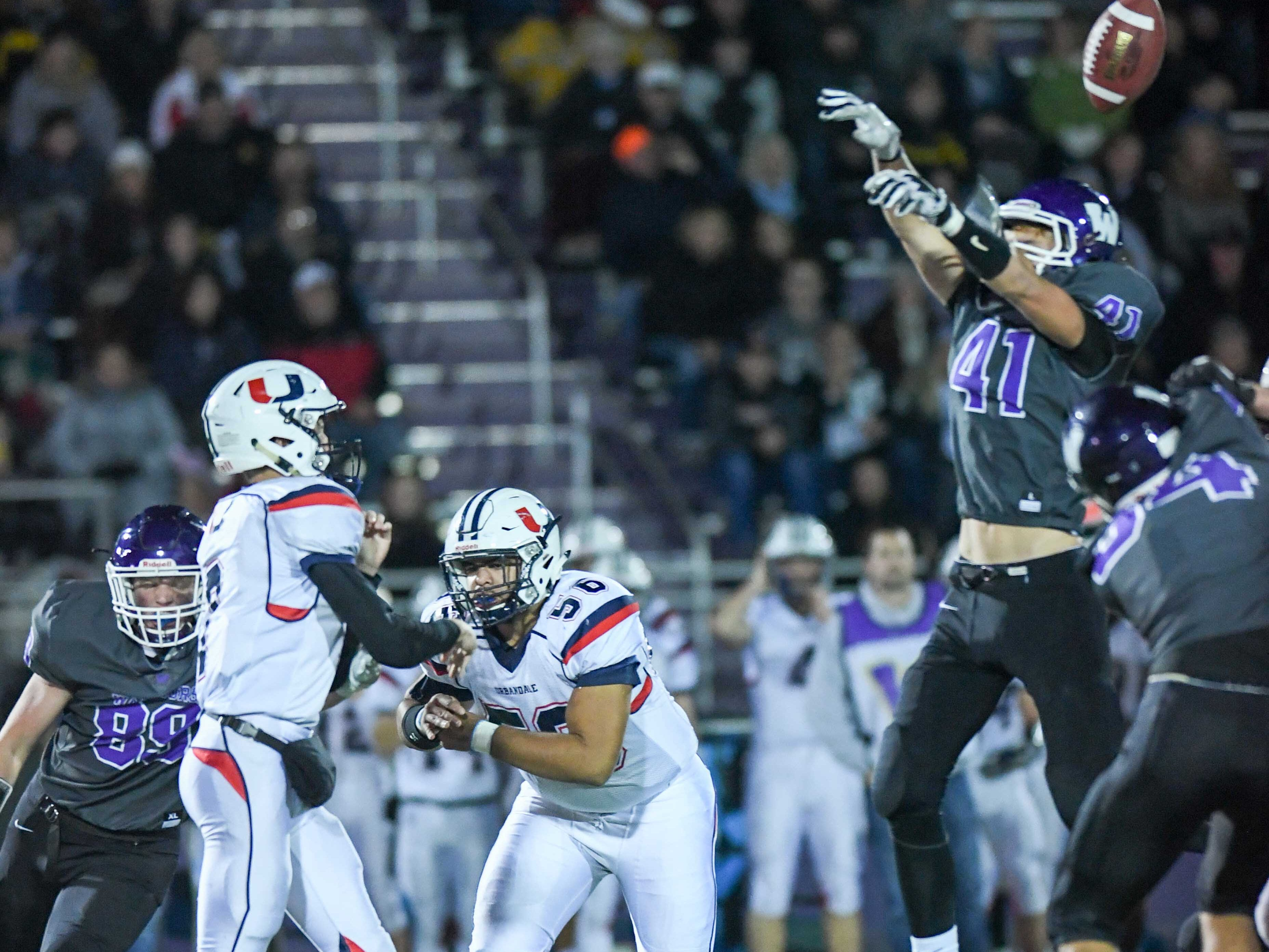 Urbandale Quarterback Ty Langenberg (7) gets his pass knocked down by Waukee's Cole Spyksma (41) on Friday, Oct. 26, 2018 during a playoff game between the Waukee Warriors and the Urbandale J-Hawks at Waukee High School.