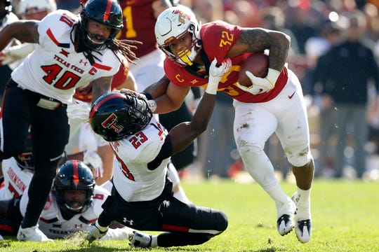 Iowa State running back David Montgomery (32) breaks a tackle by Texas Tech defensive back Damarcus Fields (23) during the first half of an NCAA college football game, Saturday, Oct. 27, 2018, in Ames, Iowa. (AP Photo/Charlie Neibergall)