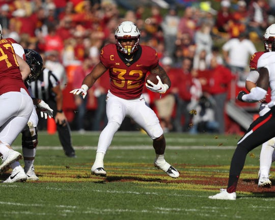 Oct 27, 2018; Ames, IA, USA; Iowa State Cyclones running back David Montgomery (32) runs the football against the Texas Tech Red Raiders at Jack Trice Stadium. Mandatory Credit: Reese Strickland-USA TODAY Sports