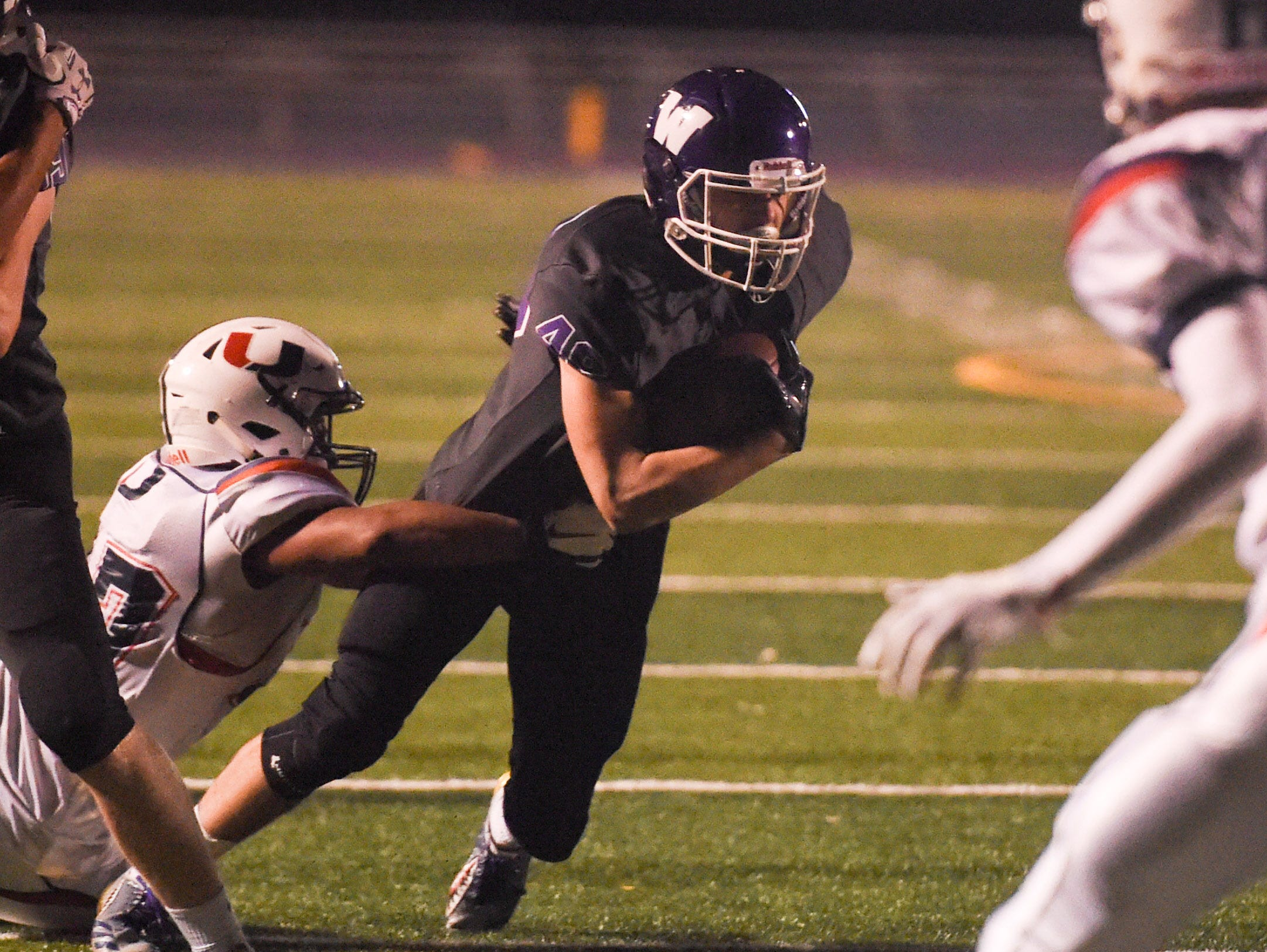 Waukee's Alex Linquist (49) carries the ball on Friday, Oct. 26, 2018 during a playoff game between the Waukee Warriors and the Urbandale J-Hawks at Waukee High School.