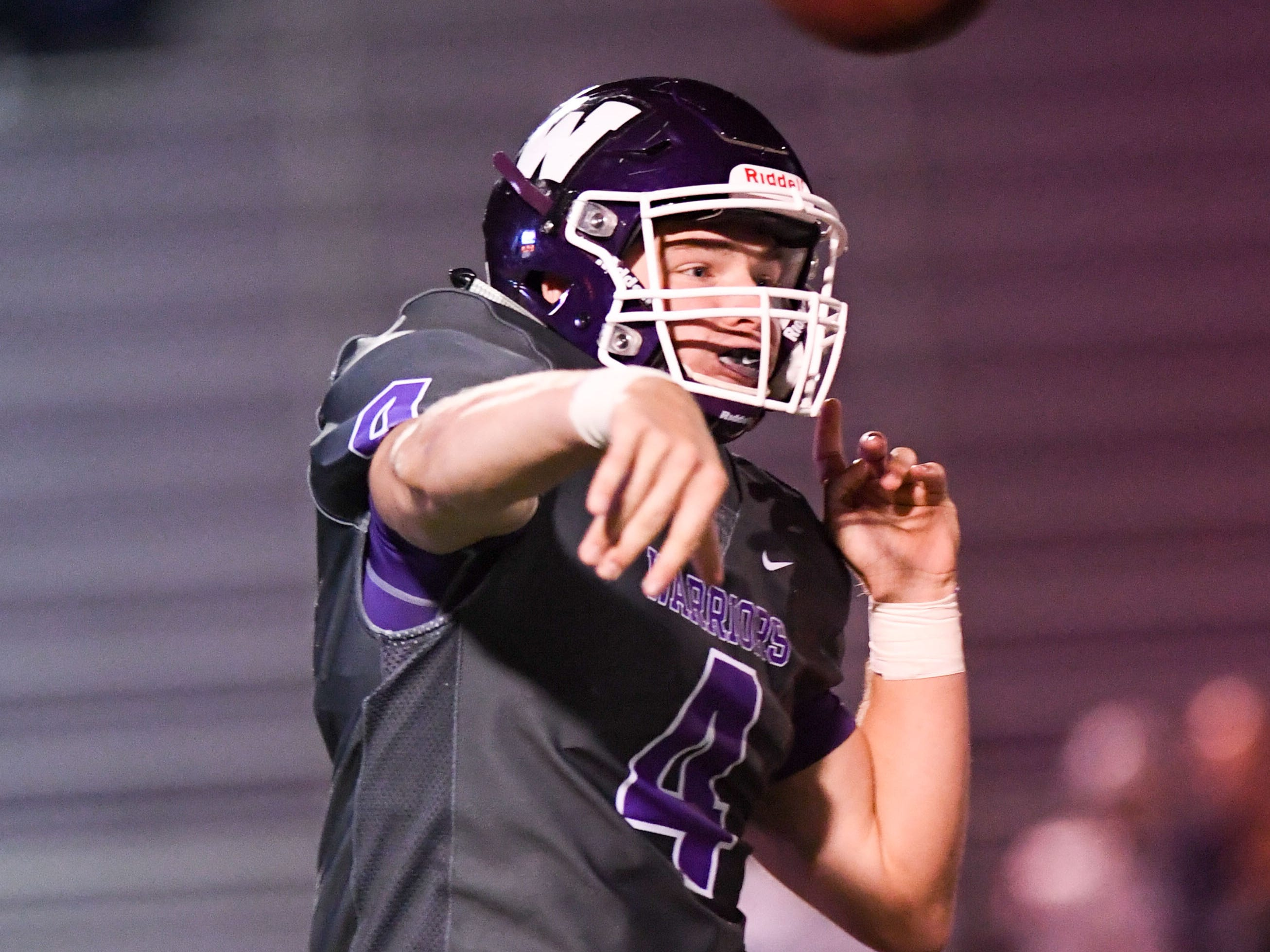 Waukee Quarterback Mitch Randall (4) makes a pass on Friday, Oct. 26, 2018 during a playoff game between the Waukee Warriors and the Urbandale J-Hawks at Waukee High School.