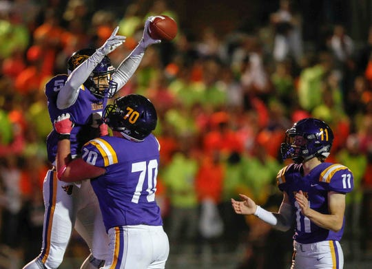 Johnston senior offensive lineman Ethan Arnold holds up receiver Anthony Coleman after Coleman ran for a touchdown against Cedar Rapids Prairie during the first round of Iowa high school football playoffs on Friday, Oct. 26, 2018.