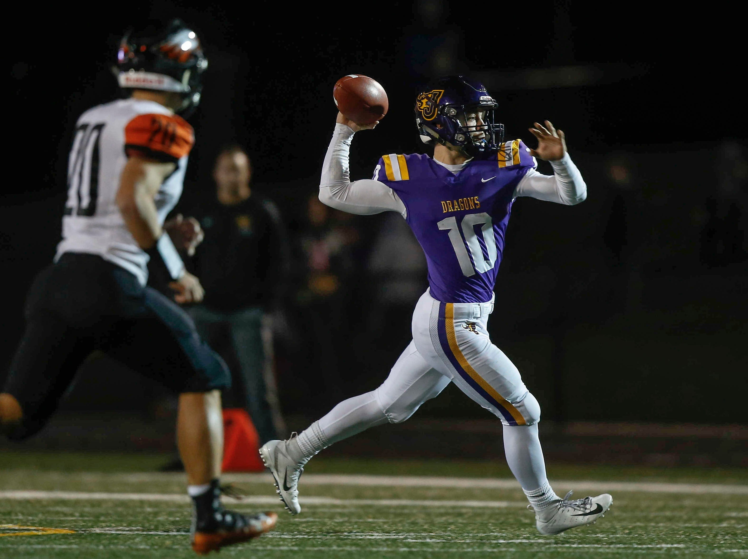 Johnston quarterback Andrew Nord fires a pass against Cedar Rapids Prairie during the first round of Iowa high school football playoffs on Friday, Oct. 26, 2018.