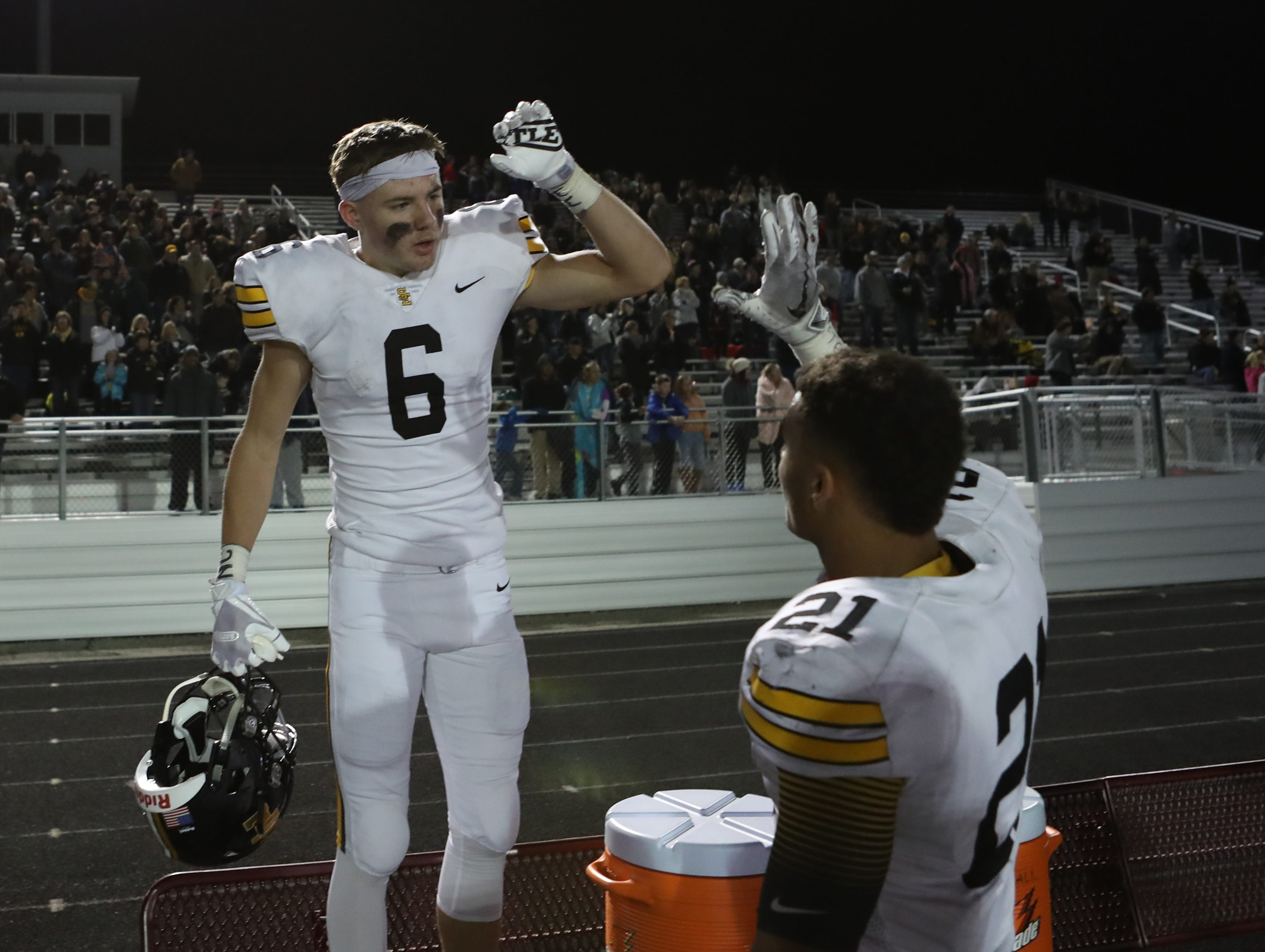 Southeast Polk Rams Dylan Travis (6) and Southeast Polk Rams Gavin Williams (21) celebrate during the final seconds of their win over the Ankeny Centennial Jaguars at Ankeny football stadium.
