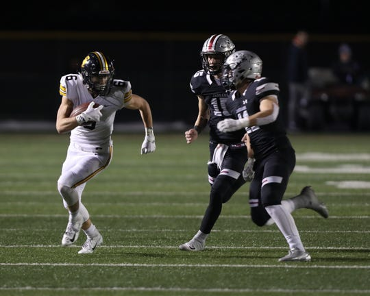 Southeast Polk Rams Dylan Travis (6) runs after the catch against the Ankeny Centennial Jaguars at Ankeny football stadium.
