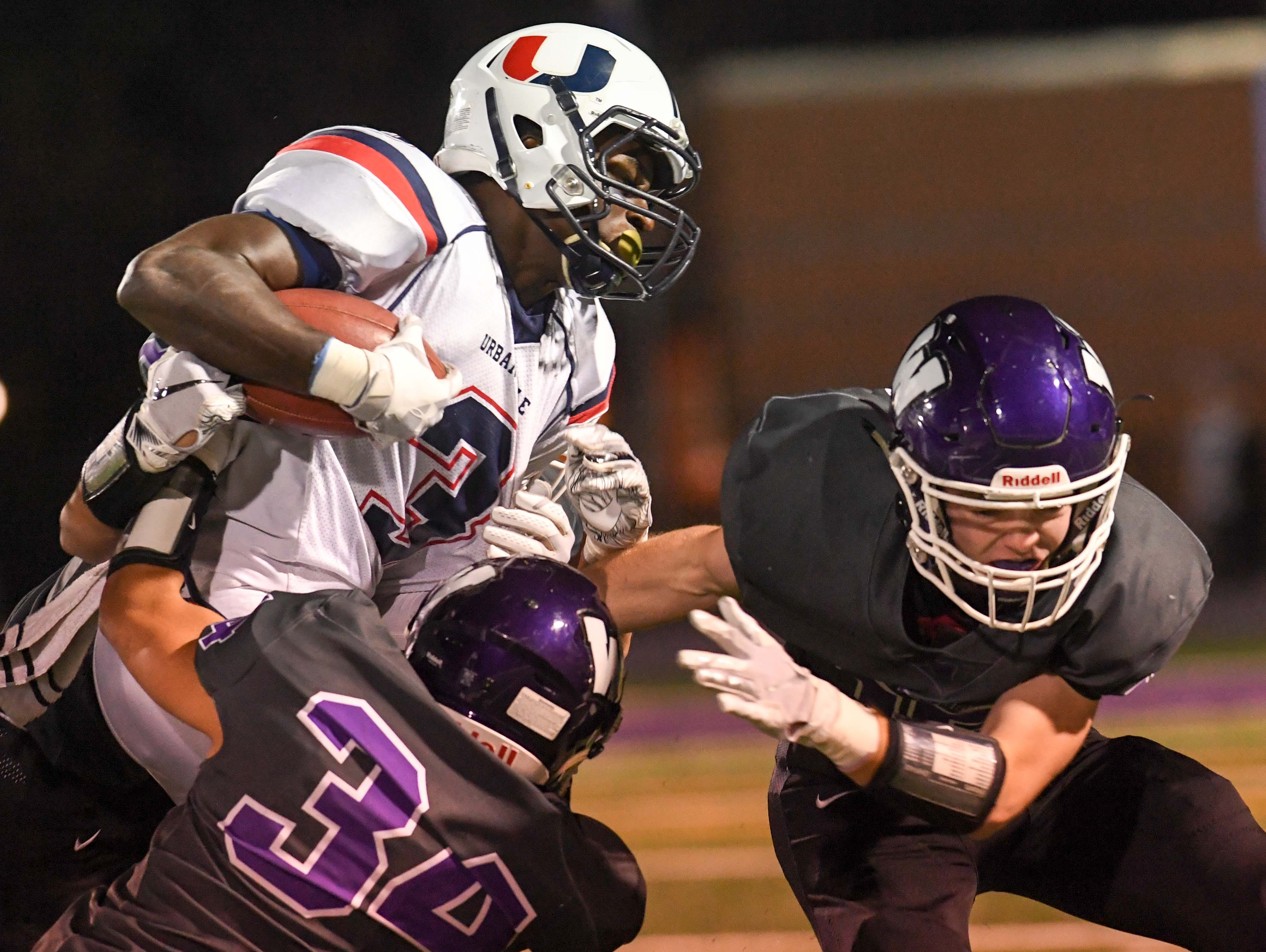 Urbandale's Harrison Waylee (3) battles down field against  Waukee defenders on Friday, Oct. 26, 2018 during a playoff game between the Waukee Warriors and the Urbandale J-Hawks at Waukee High School.