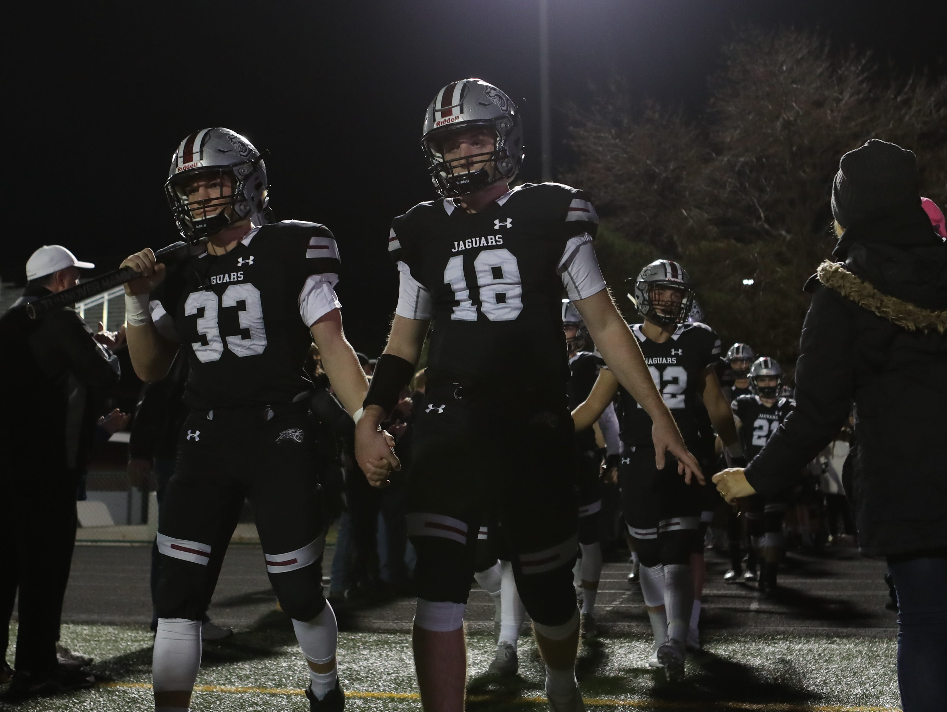 The Ankeny Centennial Jaguars enter the field before their game with the Southeast Polk Rams at Ankeny football stadium.
