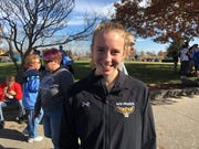 Mid-Prairie junior Marie Hostetler poses after winning the Class 2A title at the Iowa state cross country meet.