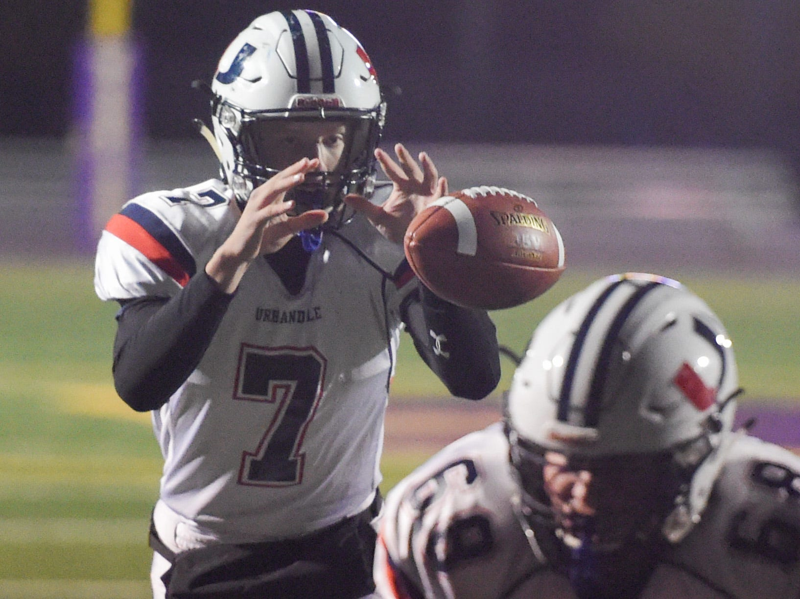 Urbandale quarterback Ty Langenberg (7) takes a snap on Friday, Oct. 26, 2018 during a playoff game between the Waukee Warriors and the Urbandale J-Hawks at Waukee High School.