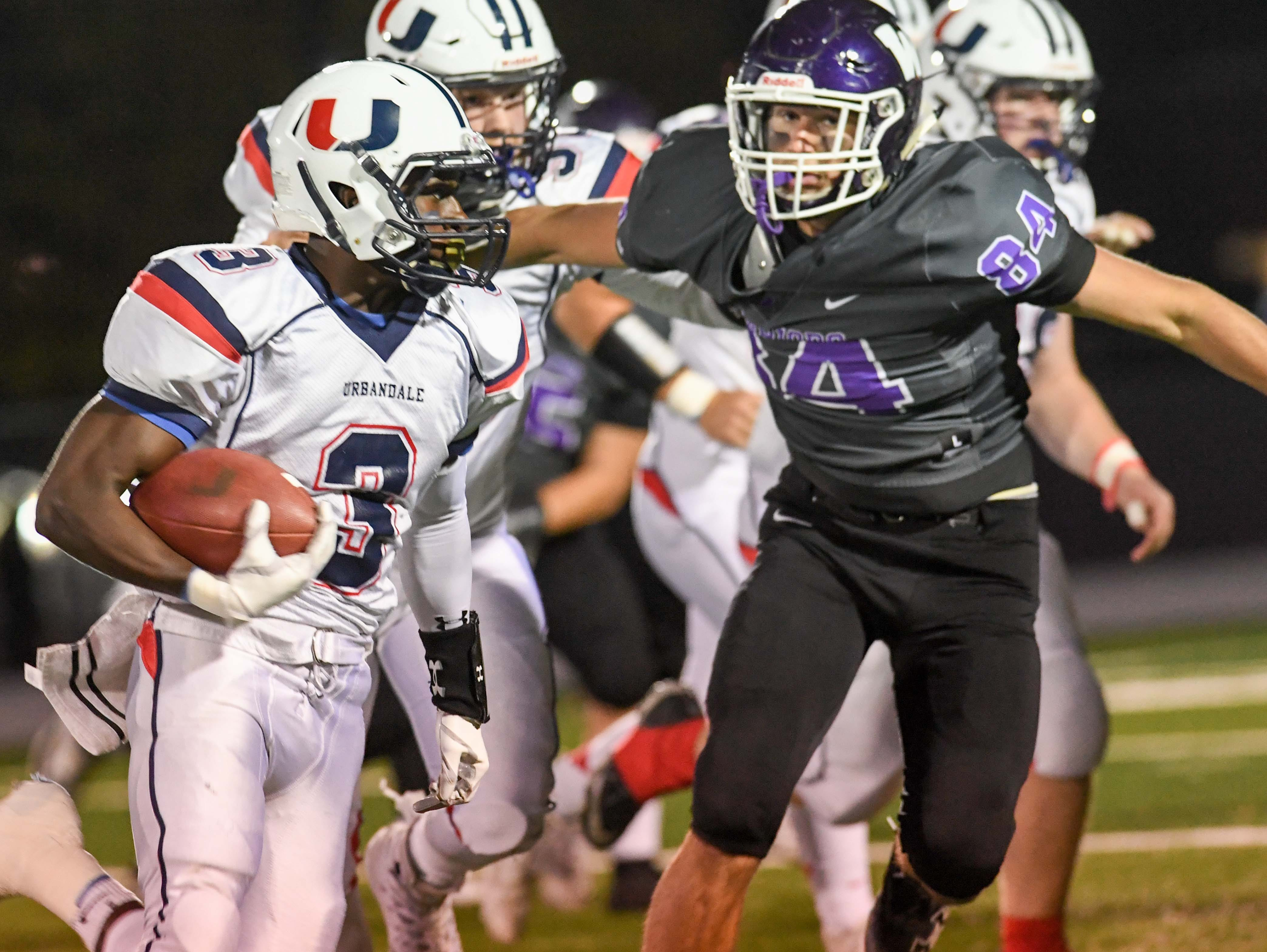 Urbandale's Harrison Waylee (3) looks for running room as  Waukee's Caleb Paulus (84) defends on Friday, Oct. 26, 2018 during a playoff game between the Waukee Warriors and the Urbandale J-Hawks at Waukee High School.
