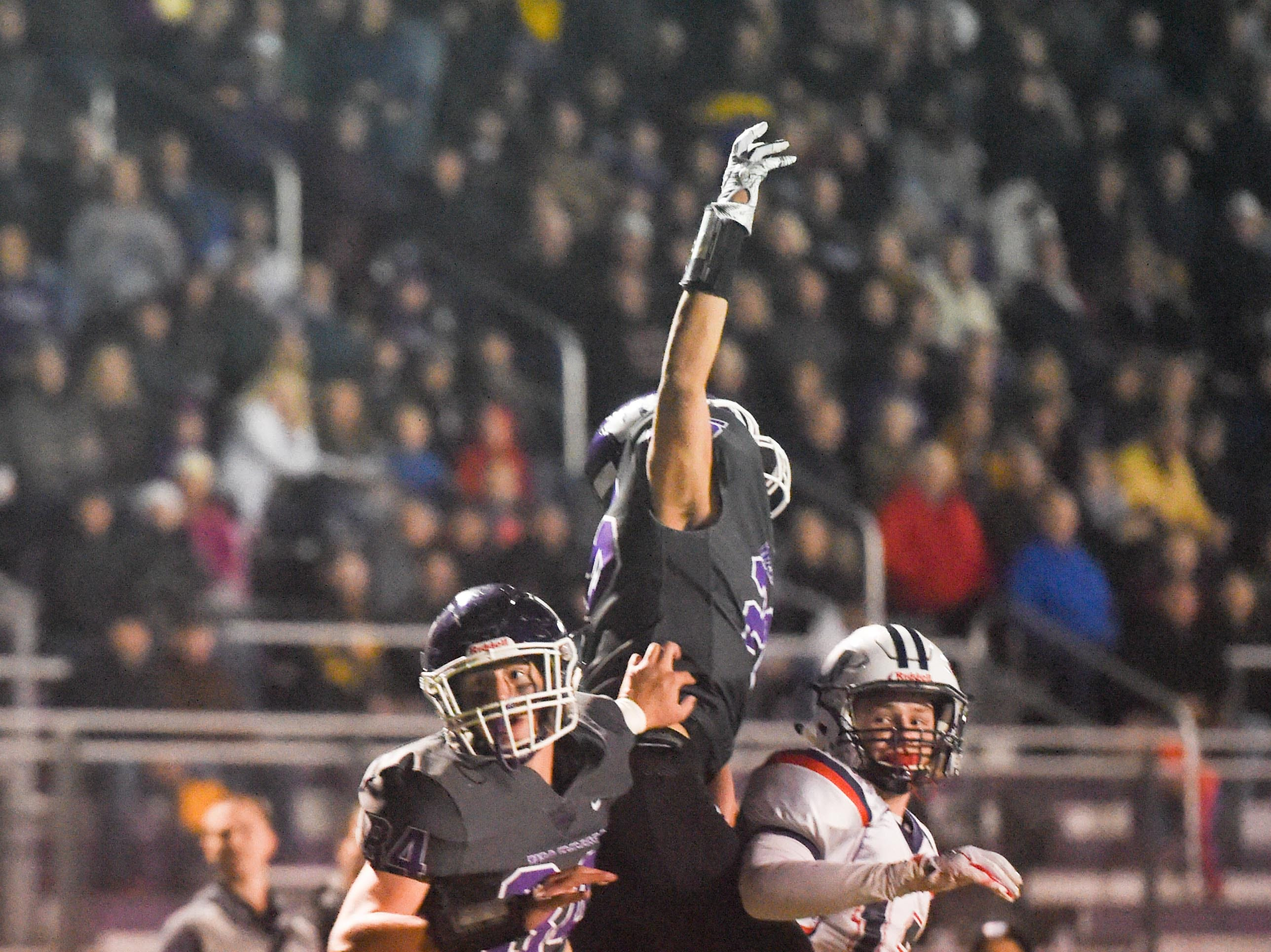 Urbandale and Waukee players watch as a pass goes deep into the endzone on Friday, Oct. 26, 2018 during a playoff game between the Waukee Warriors and the Urbandale J-Hawks at Waukee High School.