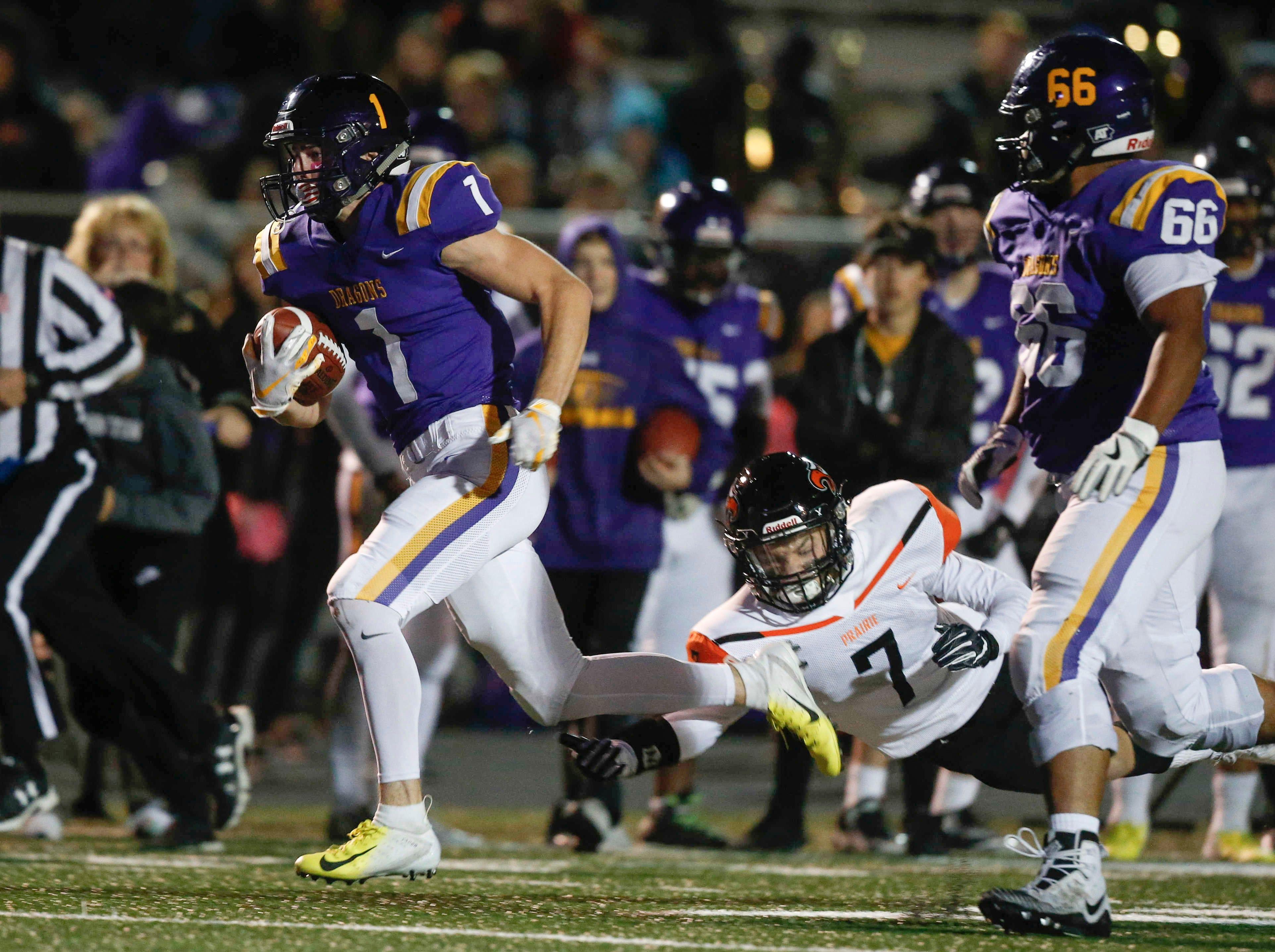 Johnston receiver Blake Murray runs the ball for a touchdown against Cedar Rapids Prairie during the first round of Iowa high school football playoffs on Friday, Oct. 26, 2018.