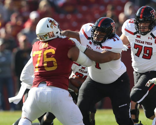 Oct 27, 2018; Ames, IA, USA; Texas Tech Red Raiders offensive lineman Jacob Hines (77) and Iowa State Cyclones defensive lineman Ray Lima (76) face off at Jack Trice Stadium. Mandatory Credit: Reese Strickland-USA TODAY Sports