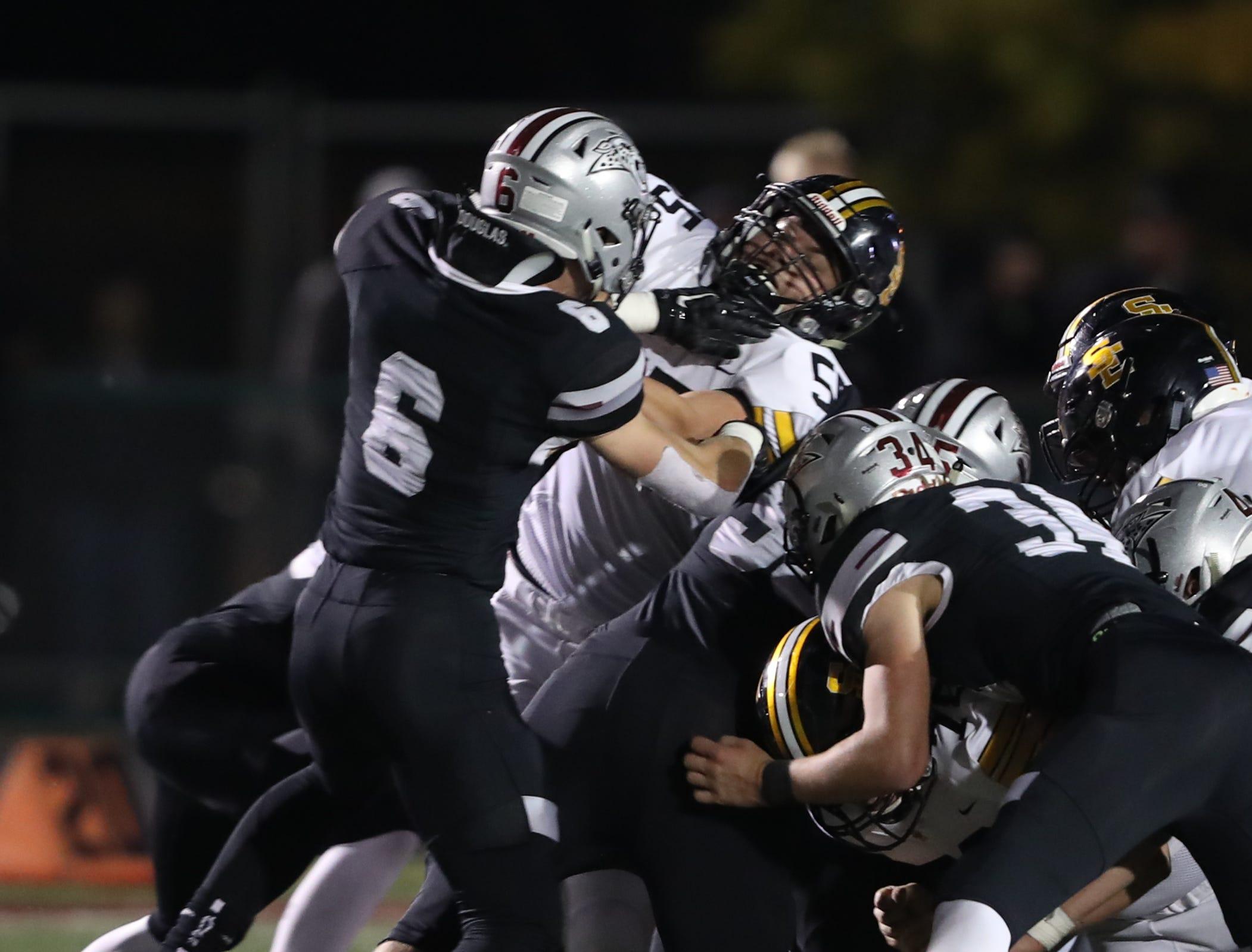 Southeast Polk Rams Luke Stephenson battles Ankeny Centennial Jaguars Scott Doup (6) at Ankeny football stadium.