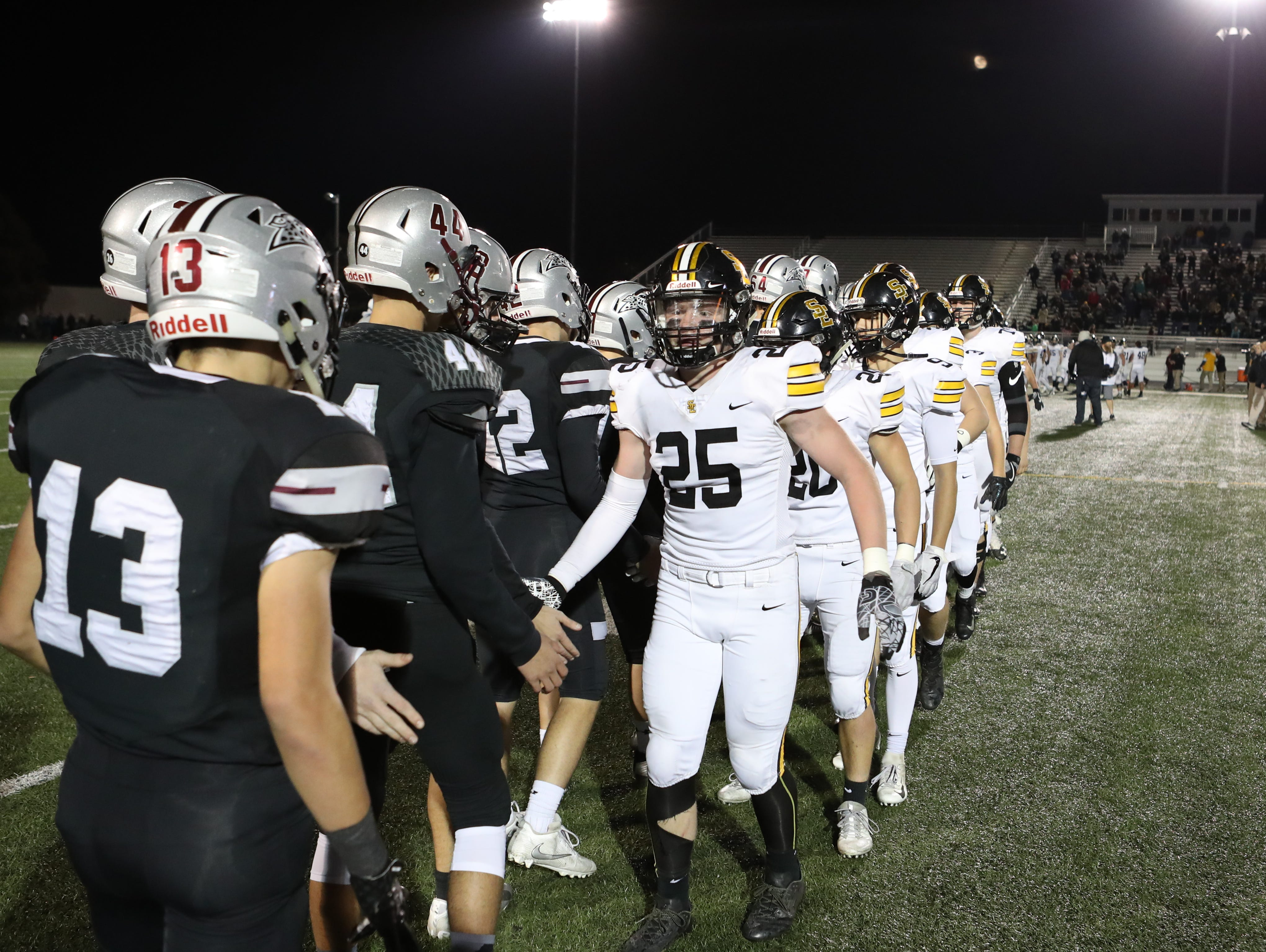 Southeast Polk Rams Zach Strickland (25) shakes hands after the game with the Ankeny Centennial Jaguars at Ankeny football stadium.