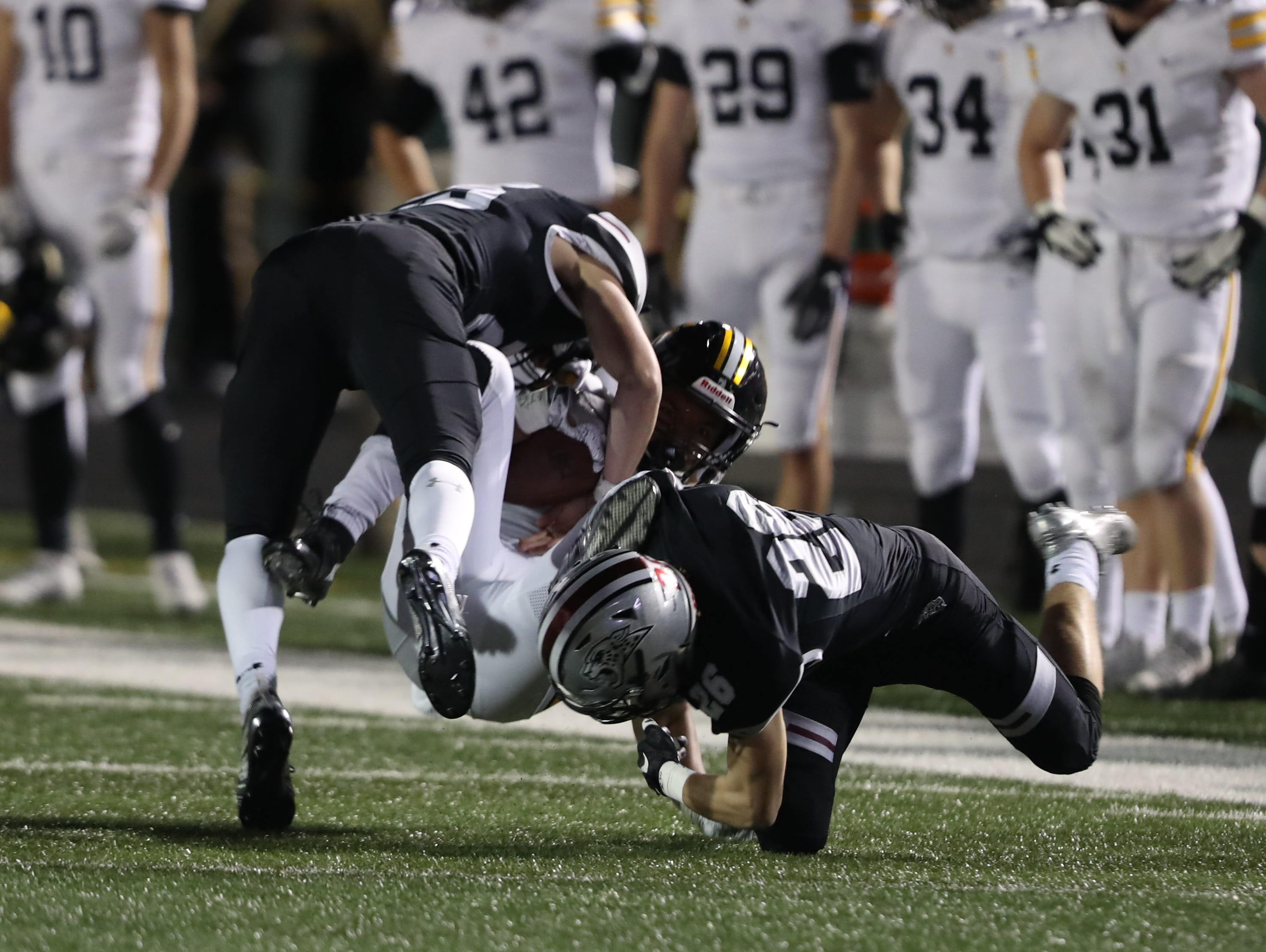 Southeast Polk Rams Isaiah Wagner (11) is tackled by the Ankeny Centennial Jaguars at Ankeny football stadium.