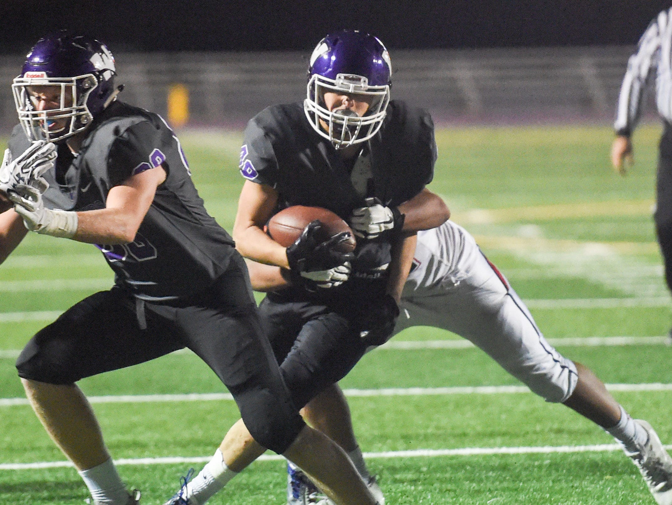 Waukee's Alex Linquist (49) fights his way down field on Friday, Oct. 26, 2018 during a playoff game between the Waukee Warriors and the Urbandale J-Hawks at Waukee High School.