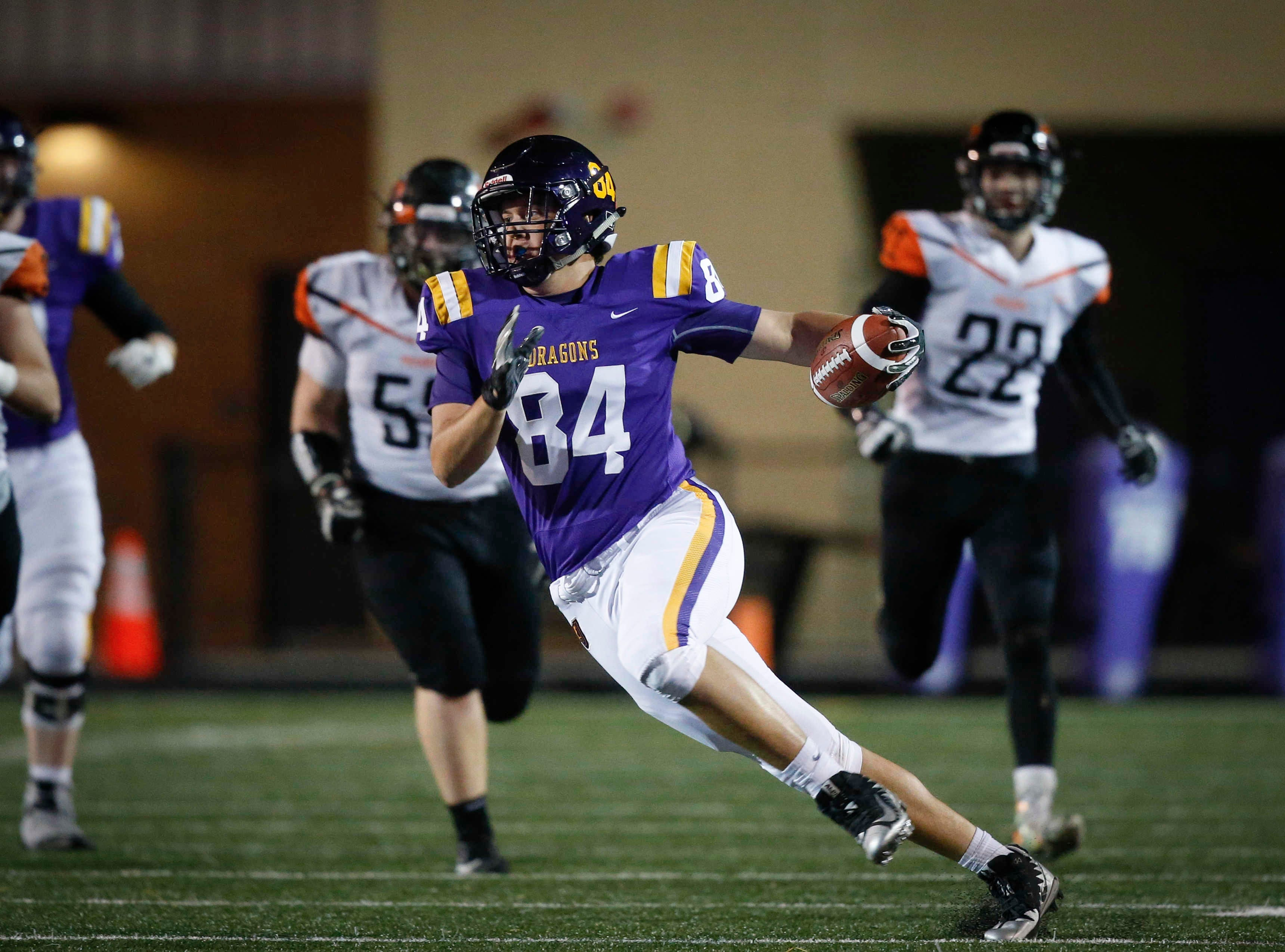 Johnston tight end Peyton Williams runs the ball after catching a pass against Cedar Rapids Prairie during the first round of Iowa high school football playoffs on Friday, Oct. 26, 2018.