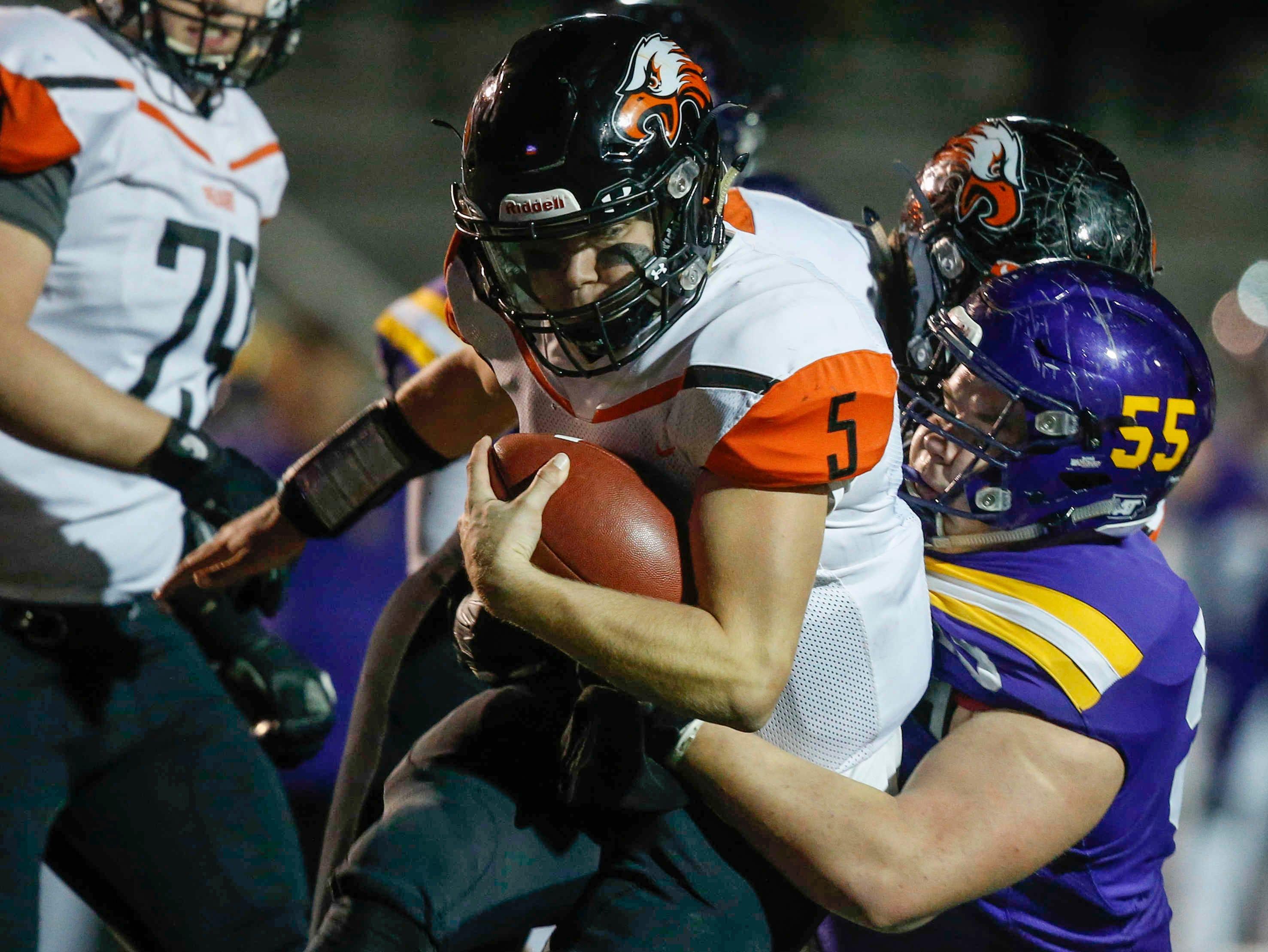 Johnston defensive lineman Brandt Howe tackles Cedar Rapids Prairie Isaak Lindgren during the first round of Iowa high school football playoffs on Friday, Oct. 26, 2018.
