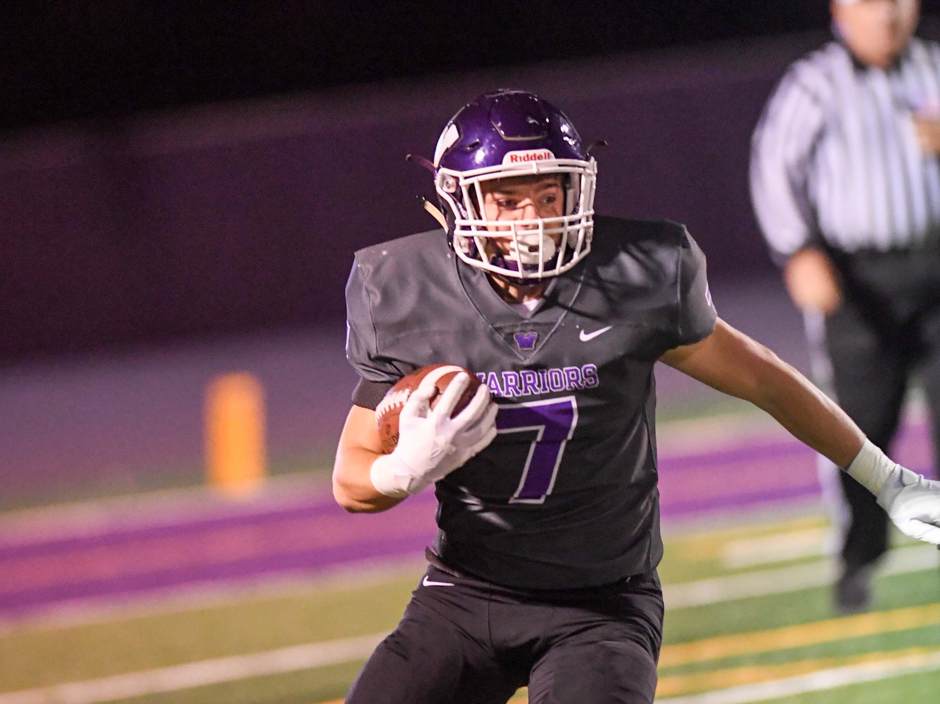 Waukee's Blake Espeland (7) runs the ball to open ground on Friday, Oct. 26, 2018 during a playoff game between the Waukee Warriors and the Urbandale J-Hawks at Waukee High School.