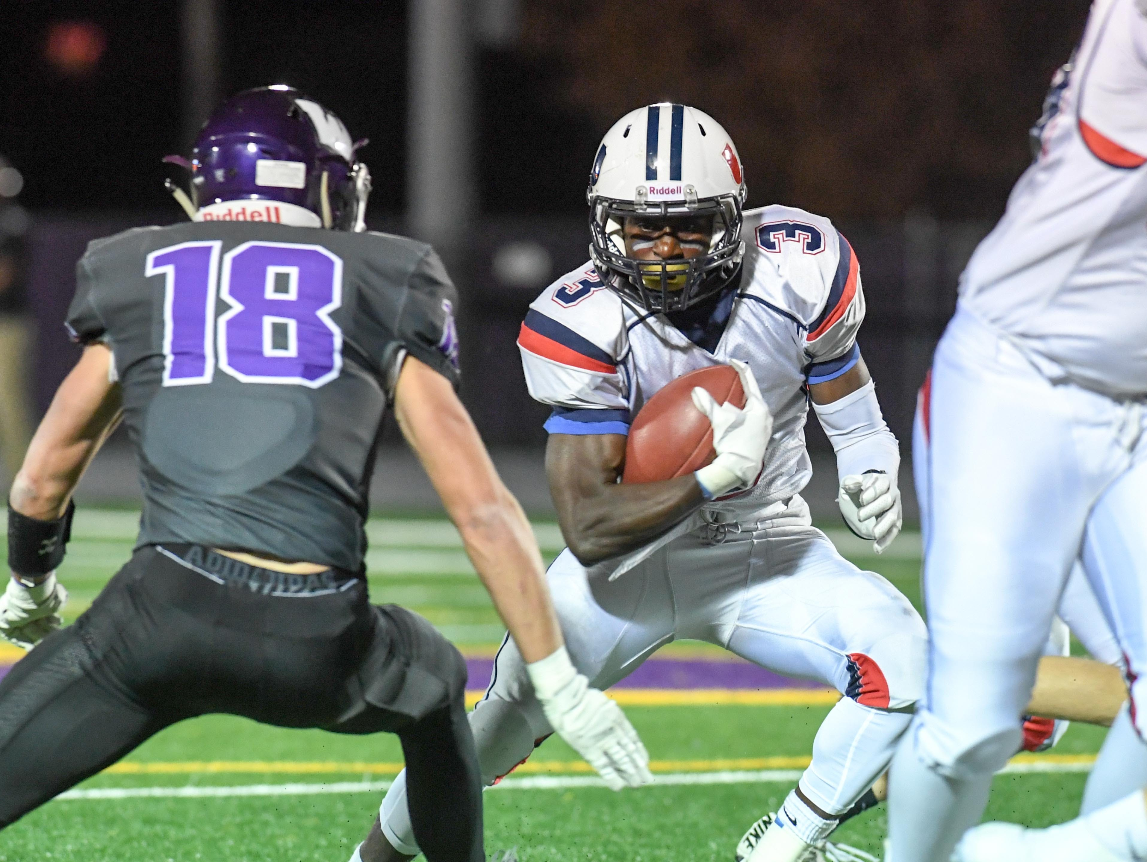 Urbandale's Harrison Waylee (3) looks for running room as  Waukee's Zach Eaton (18) defends on Friday, Oct. 26, 2018 during a playoff game between the Waukee Warriors and the Urbandale J-Hawks at Waukee High School.