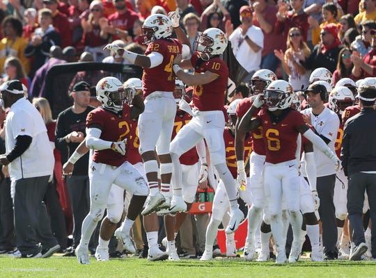Iowa State linebacker Marcel Spears Jr. celebrates with teammate Brian Peavy after his pick-six interception. Spears had two picks in the game.