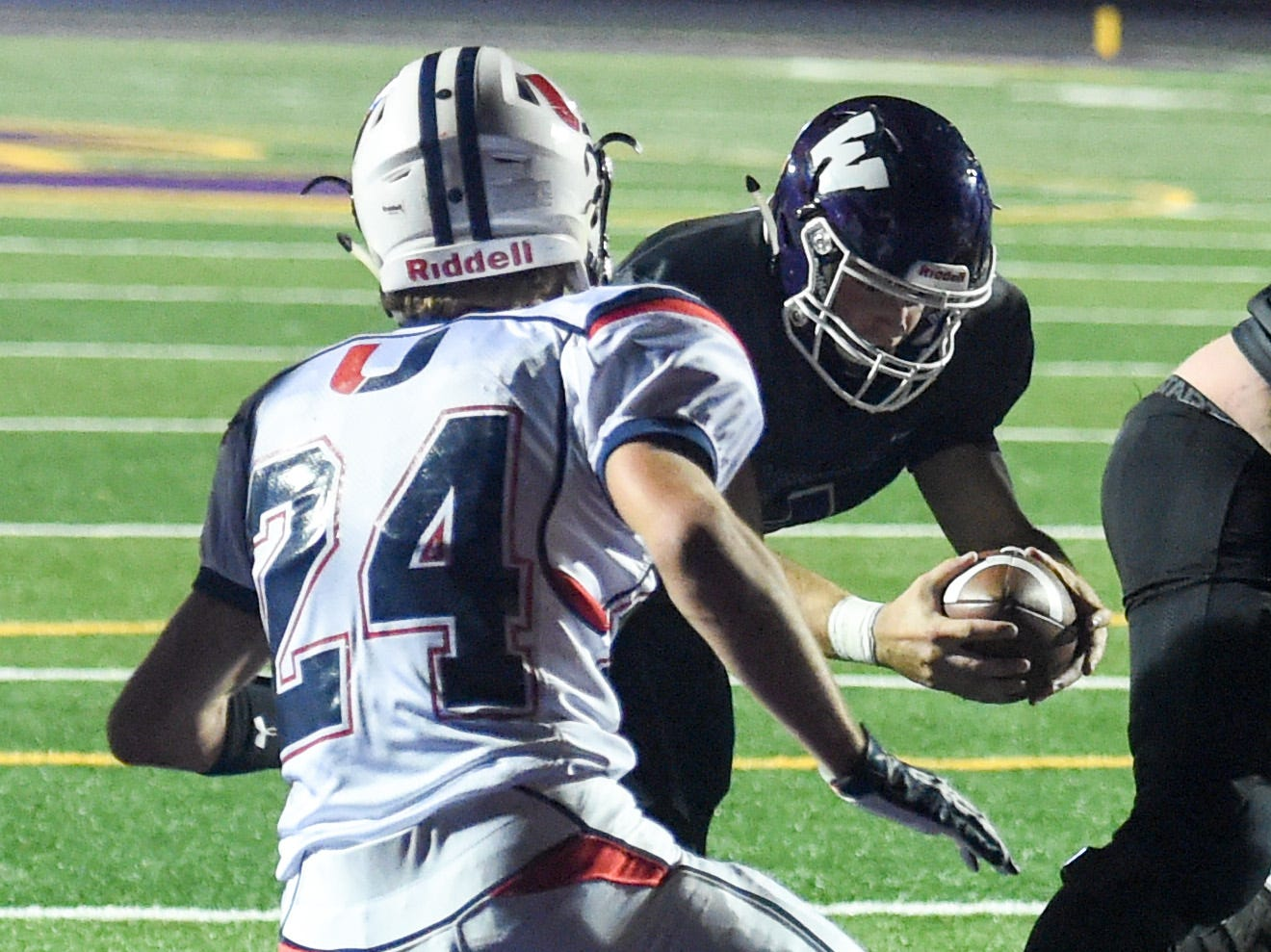 Urbandale's Hayden Friedrichsen (24) defends as Waukee Quarterback Mitch Randall (4) dives for the goal line on Friday, Oct. 26, 2018 during a playoff game between the Waukee Warriors and the Urbandale J-Hawks at Waukee High School.