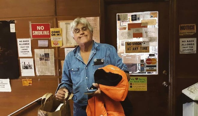 Comedian Jay Leno stopped into John K. King Used & Rare Books into Detroit on Friday, Oct. 26, 2018 and browsed the famous bookstore's automotive section.