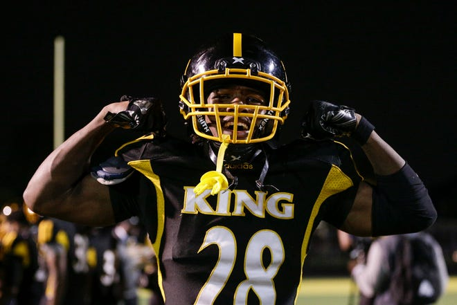 Detroit King defensive back Jamel Fortune celebrates King's 7-6 playoff win over River Rouge at King High School in Detroit, Friday, Oct. 26, 2018.