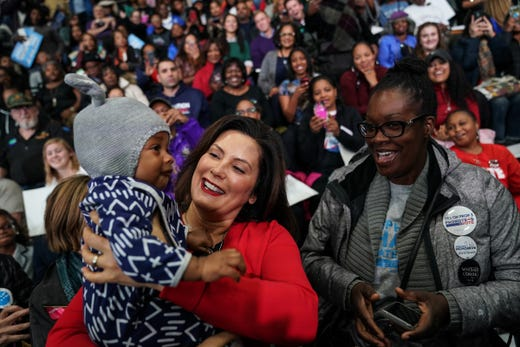 Democratic gubernatorial candidate Gretchen Whitmer holds Stephen Robinson of Warren while his mother Tomicka Robinson prepares to launch the Michigan Get Out The Vote Rally of the Democratic Party of Michigan on Friday, October 26, 2018 in Detroit, Cass Tech High School
