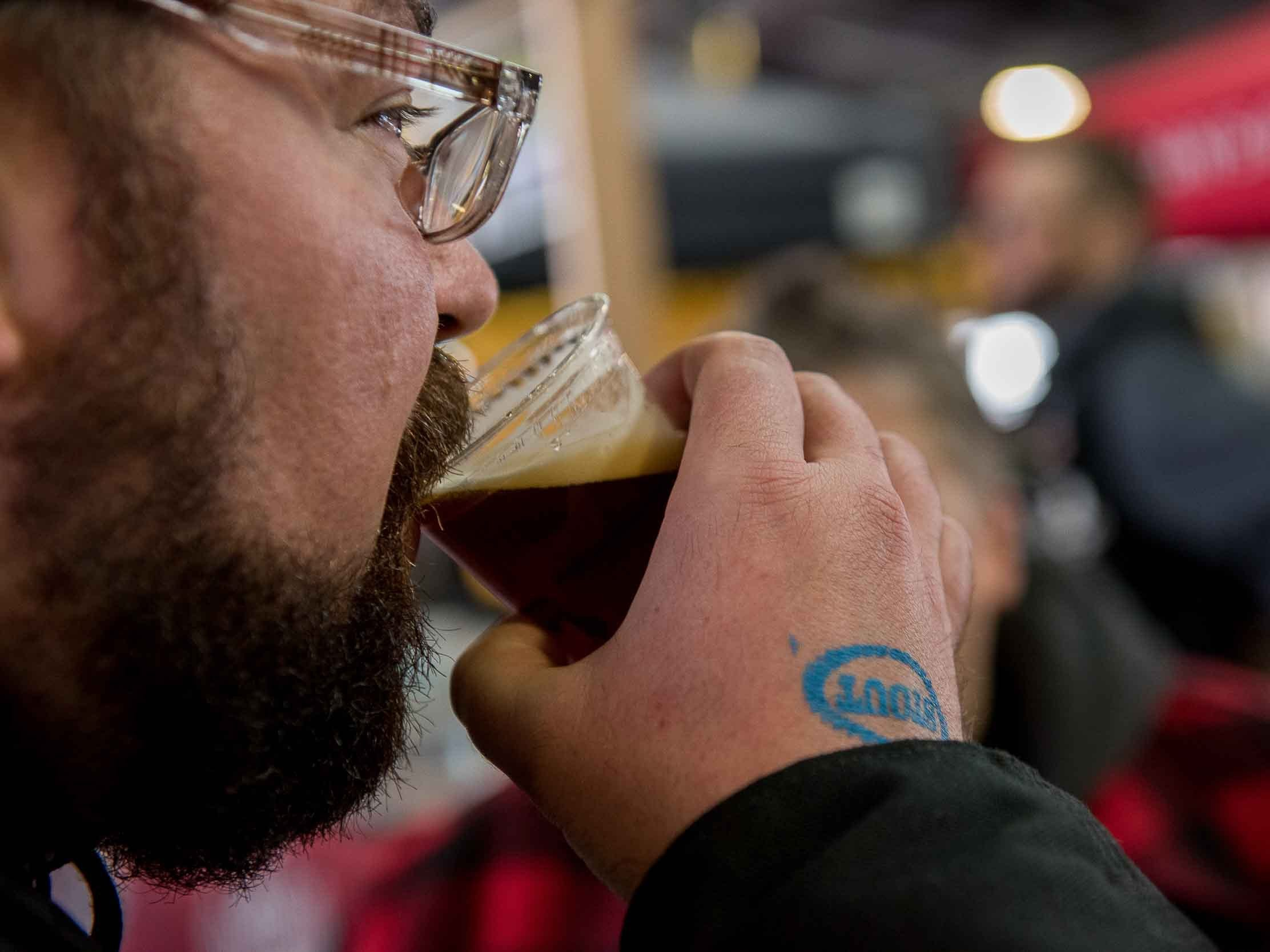 Free Press writer Robert Allen samples Schmulz Brewing Canibal Marinade during the Michigan Brewers guild annual Detroit fall beer festival at Eastern Market Oct. 26, 2018.