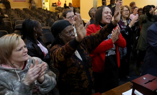 People rejoice during prayer at the former Cantrell Funeral Home in Detroit on Saturday, October 27, 2018.  Over 100 attended a prayer breakfast for the remains of babies found in a ceiling.