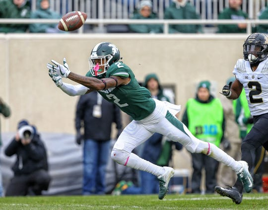 Michigan State Spartans cornerback Justin Layne (2) attempts to make a catch during the first quarter of a game against the Purdue Boilermakers at Spartan Stadium.