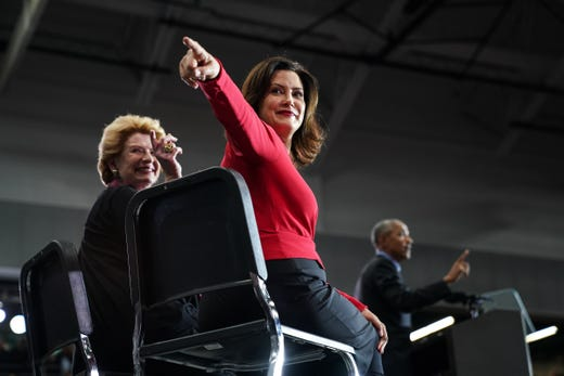 Democratic gubernatorial candidate Gretchen Whitmer and Senator Debbie Stabenow refer back to the crowd as 44th President of the United States Barack Obama speaks during Michigan Rallying Democratic Party Michigan Rally Friday, October 26, 2018 at Detroit Cass Tech High School.