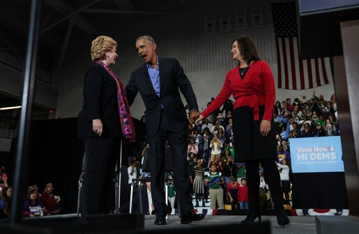44. President of the United States Barack Obama stands with democratic gubernatorial candidate Gretchen Whitmer, right, and Sen. Debbie Stabenow during the Michigan Get Out of the Voting Democratic Rally Michigan on Friday, October 26, 2018 at Detroit's Cass Tech High School