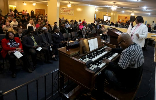 Reynold Hemphill an organist for Davison Baptist Church in Detroit plays a song as over 100 people listen to him in the chapel at the former Cantrell Funeral Home in Detroit on Saturday, October 27, 2018 during a prayer breakfast for the remains of babies found in a ceiling.