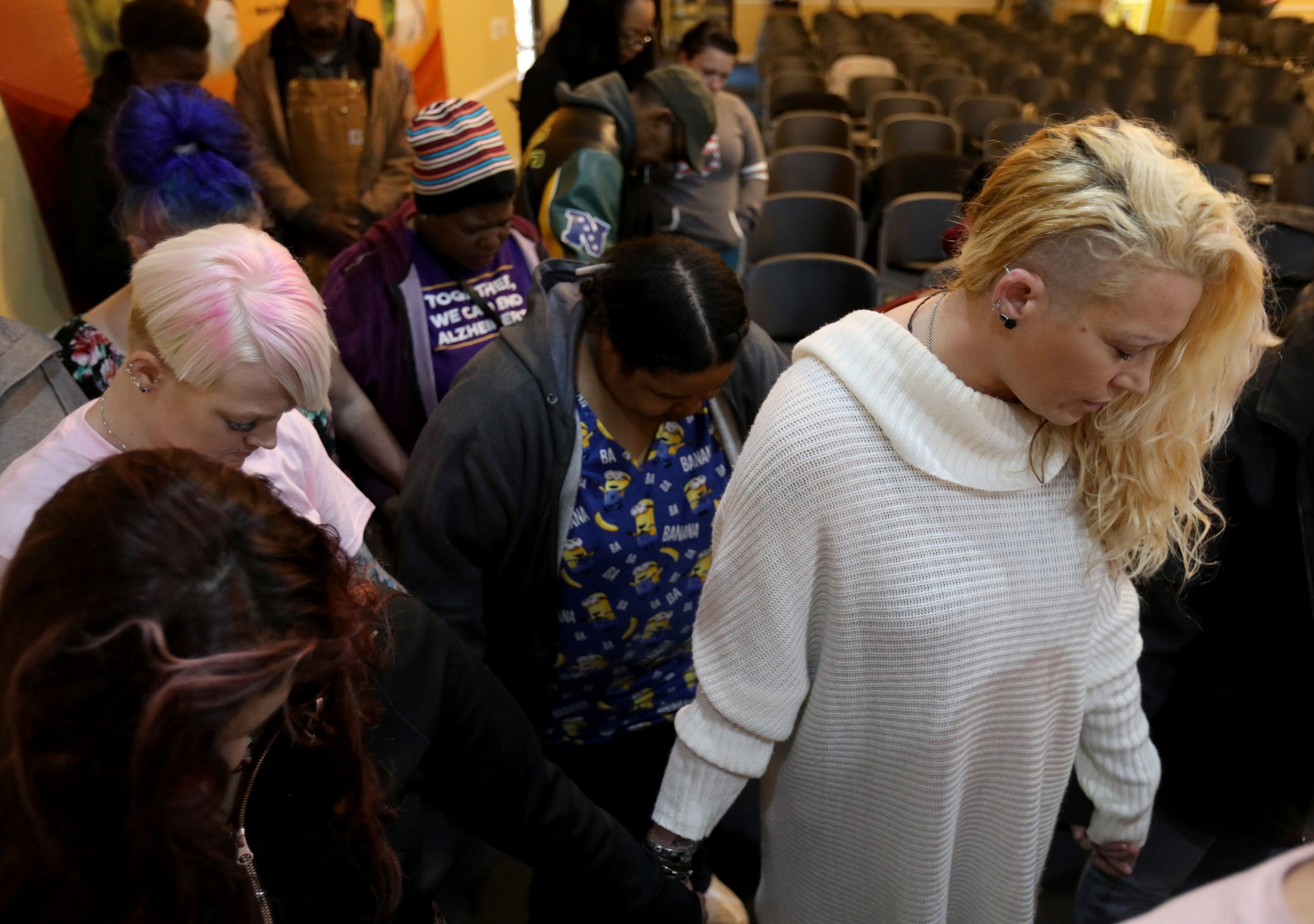 Megan Crisp, far right, holds hands with others during a prayer session in the chapel at the former Cantrell Funeral Home in Detroit on Saturday, October 27, 2018. A prayer breakfast was held for the remains of the fetuses found in a ceiling.