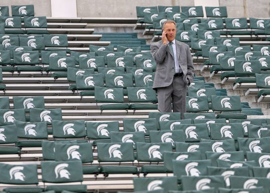 Michigan State football coach Mark Dantonio makes a call from the stands prior to a game against the Purdue Boilermakers at Spartan Stadium on Oct. 27, 2018.