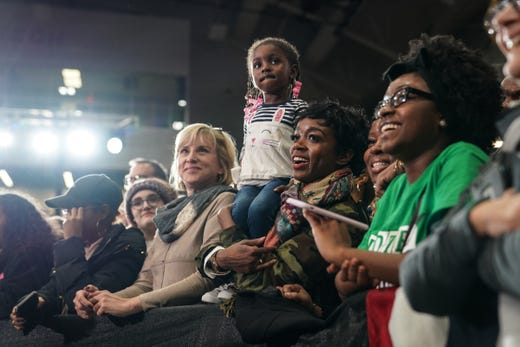 People watch as the 44th United States President Barack Obama speaks at Detroit Cass Tech High School's polling rally from the Democratic Party of Michigan on Friday, October 26, 2018 during the Michigan match ,