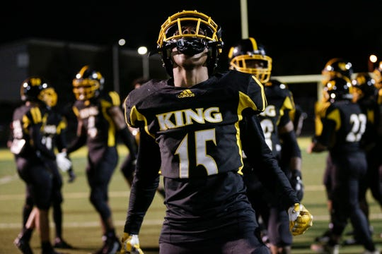 Detroit King receiver Dominick Polidore-Hannah (15) celebrates the 7-6 playoff win over River Rouge at King High School in Detroit, Friday, Oct. 26, 2018.