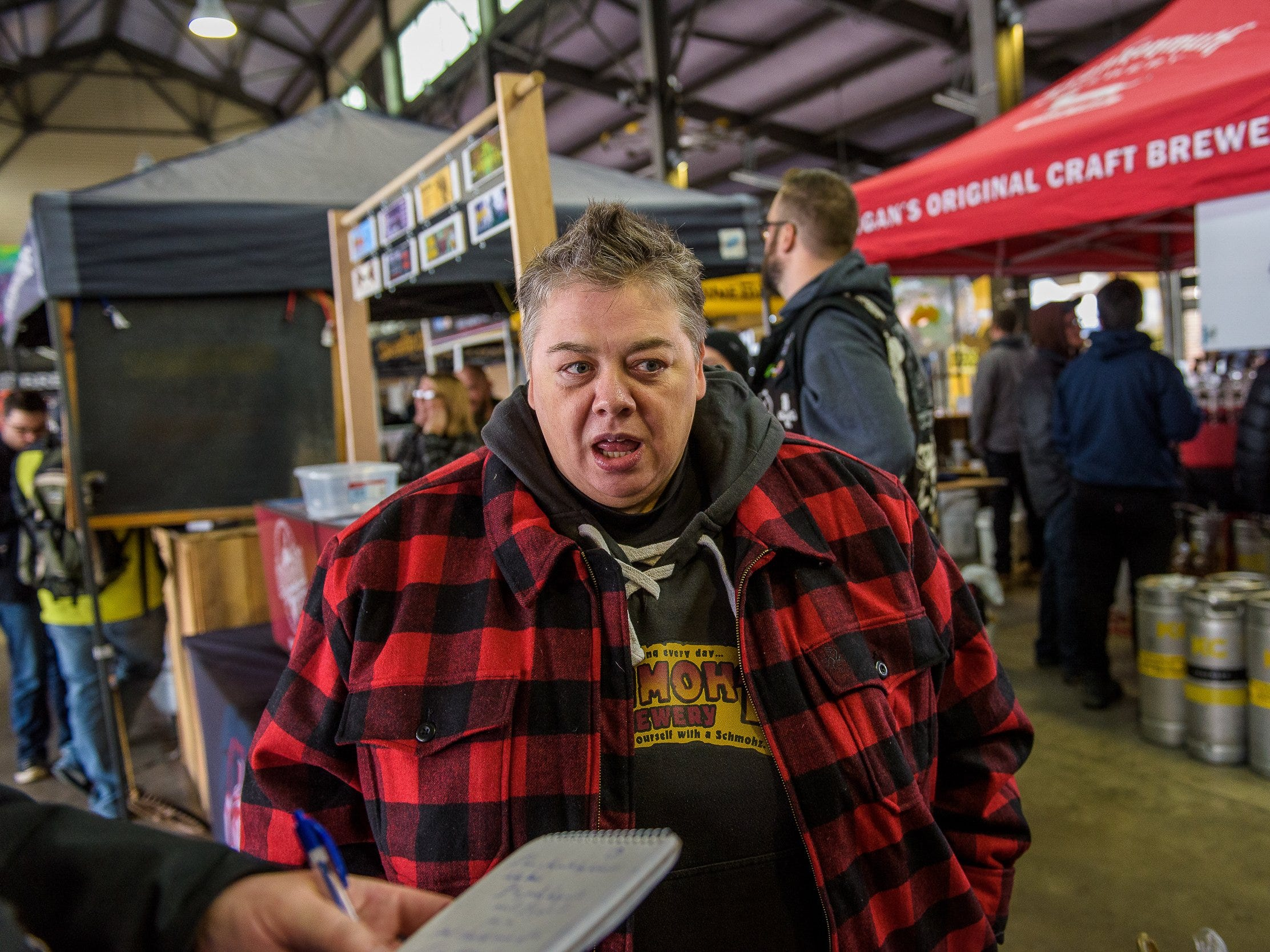Gabby Palmer of Schmulz Brewing during the Michigan Brewers guild annual Detroit fall beer festival at Eastern Market Oct. 26, 2018.
