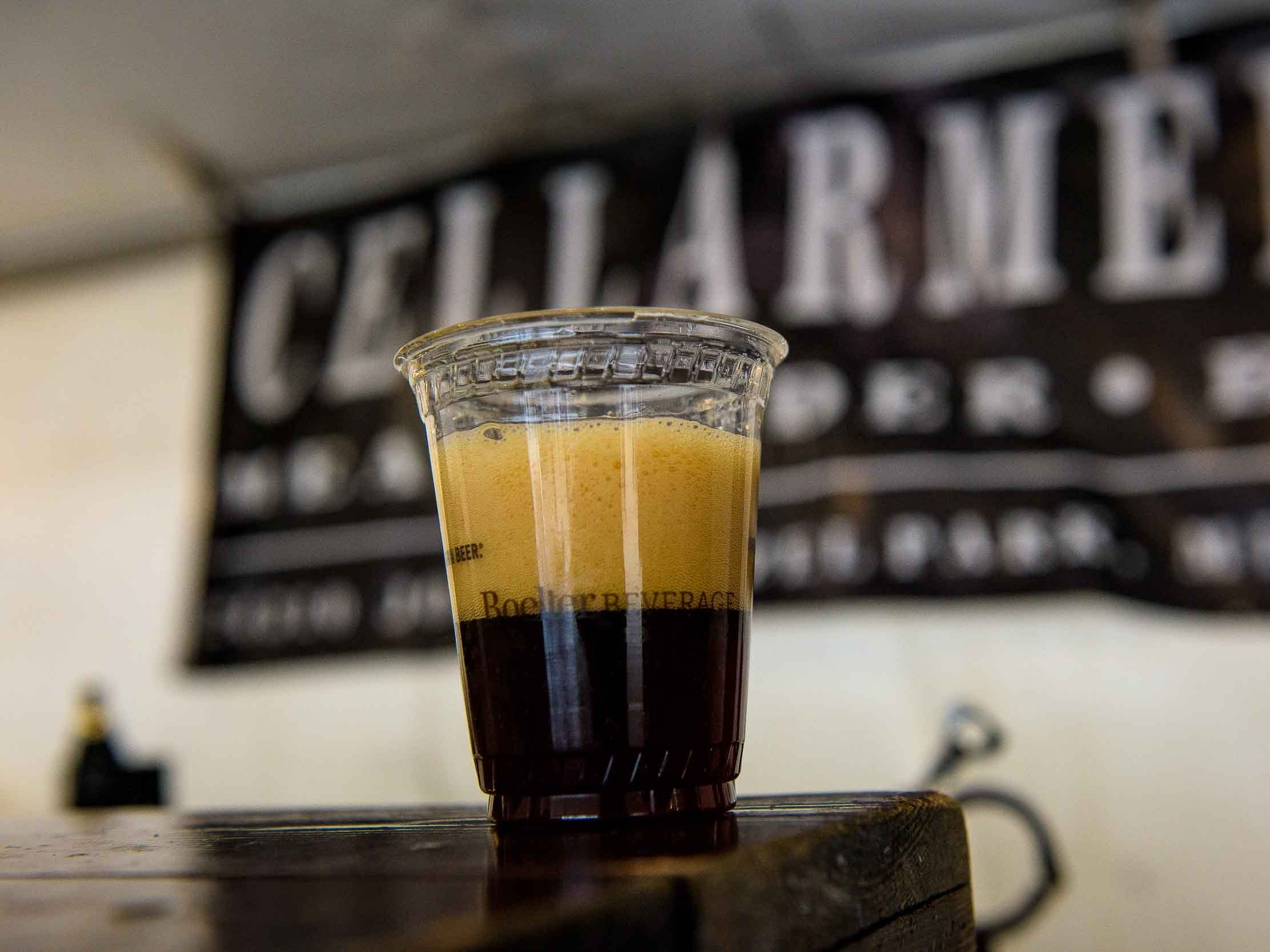 A sampling Deer crossing Ale from Cellarman's Brewing is presented by Cellarmans Brewery, Hazel Park during the Michigan Brewers guild annual Detroit fall beer festival at Eastern Market Oct. 26, 2018.