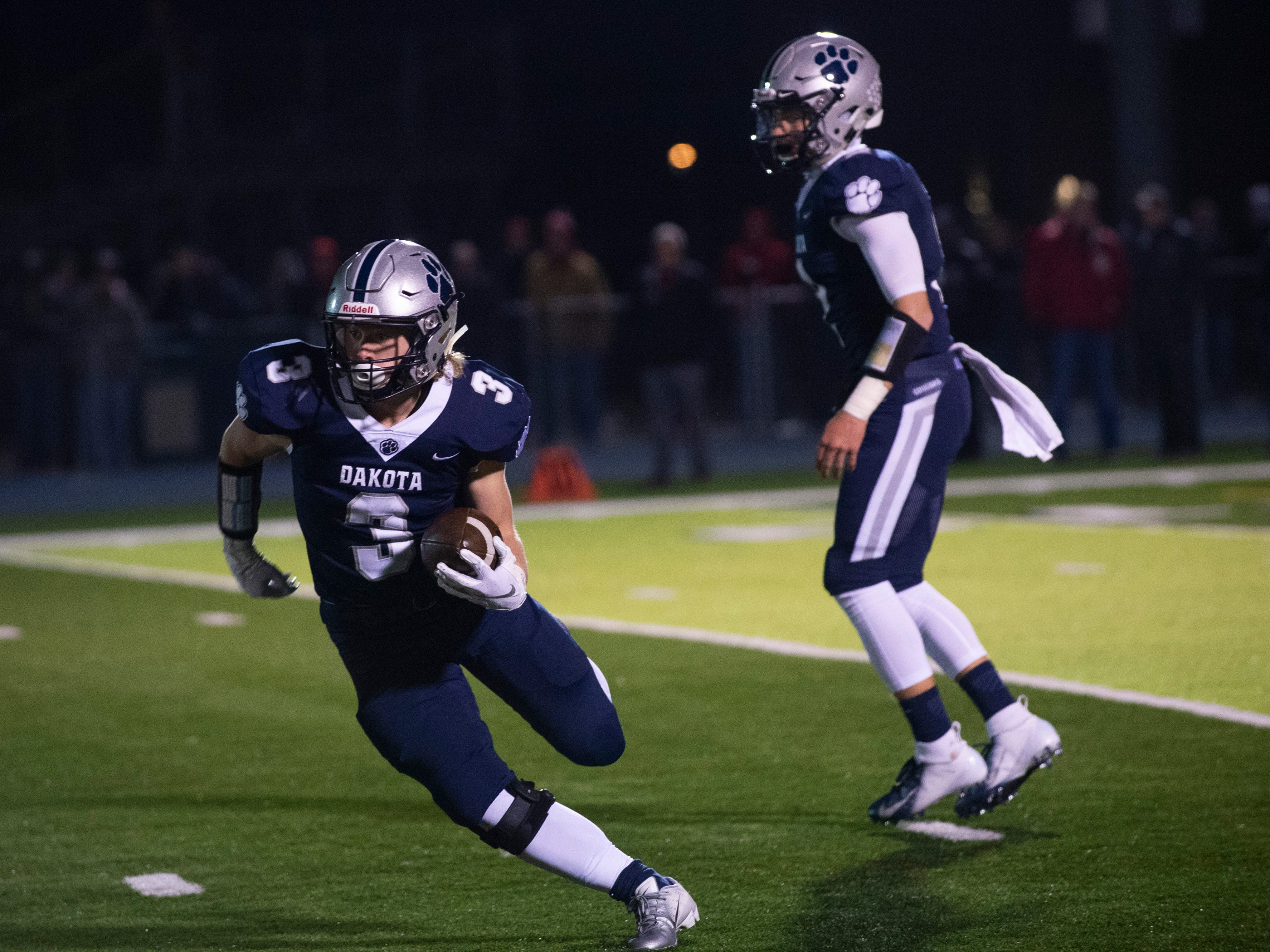 Dakota's Dustin Soloman moves with the ball during the 2nd quarter.