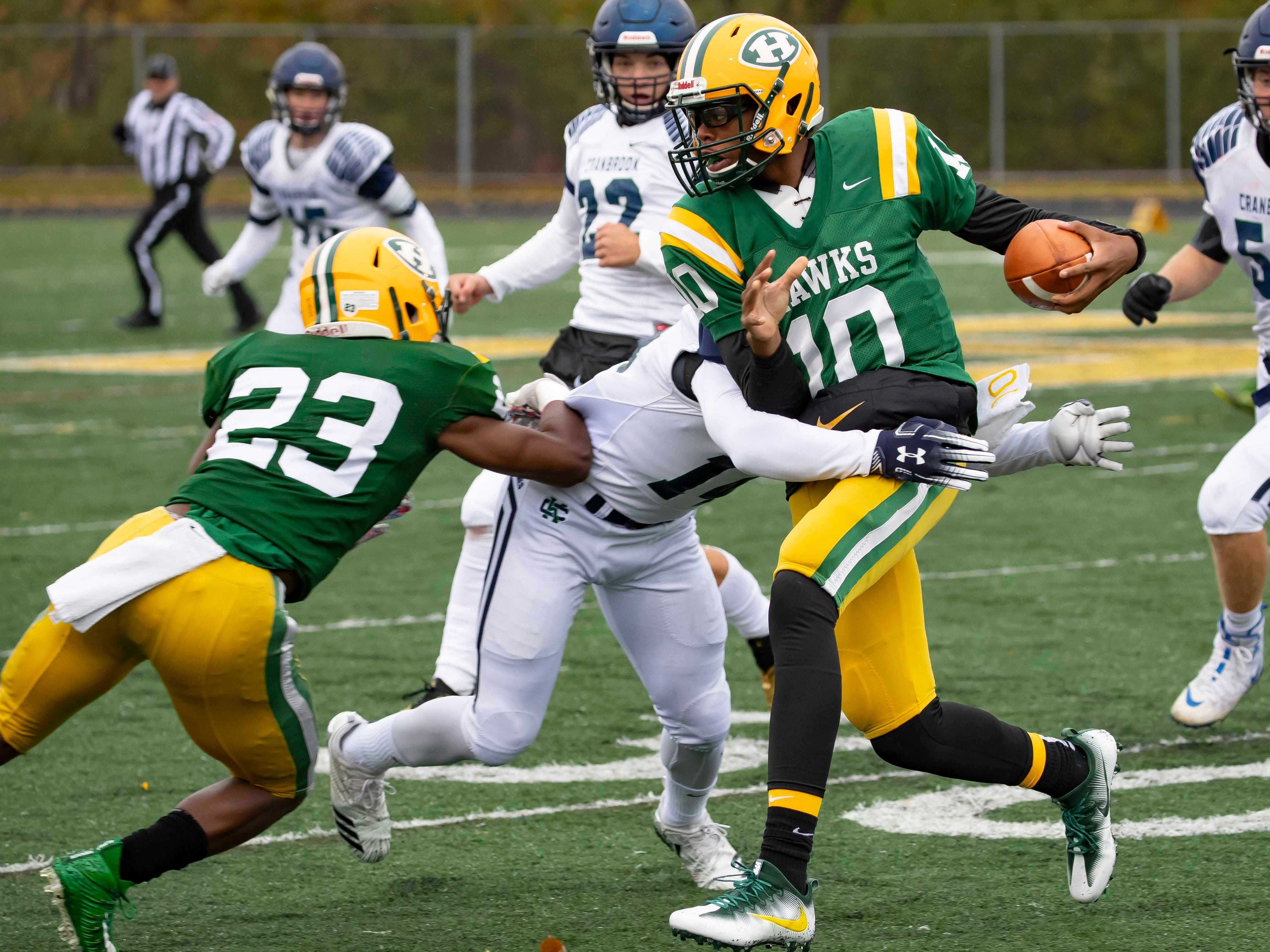 Keel Watson (10) of Farmington Hills Harrison Hawks is tackled by Torrell Williams (11) of Cranbrook Kingswood in the first half of a 24-10 playoff victory for Harrison at John Herrington Athletic Complex at Buller Field on October 27, 2018 in Farmington Hills, Michigan.