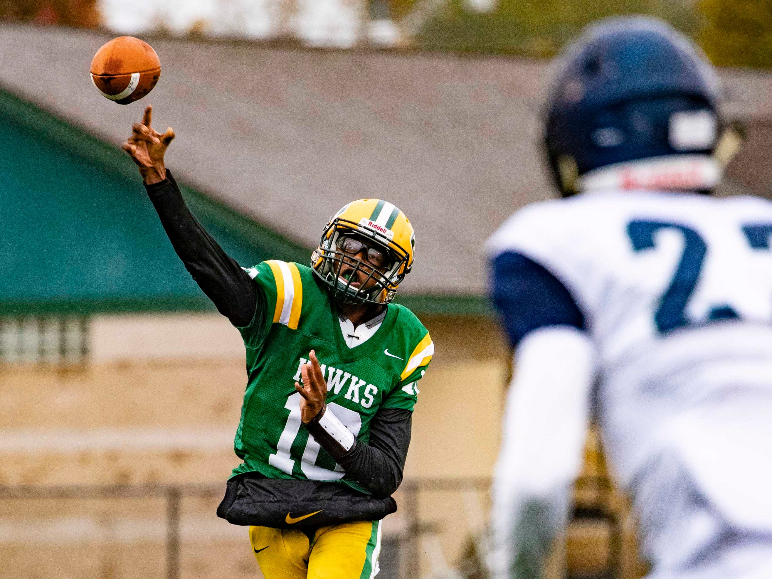 Keel Watson (10) of Farmington Hills Harrison Hawks throws the football against Cranbrook Kingswood in the first half.