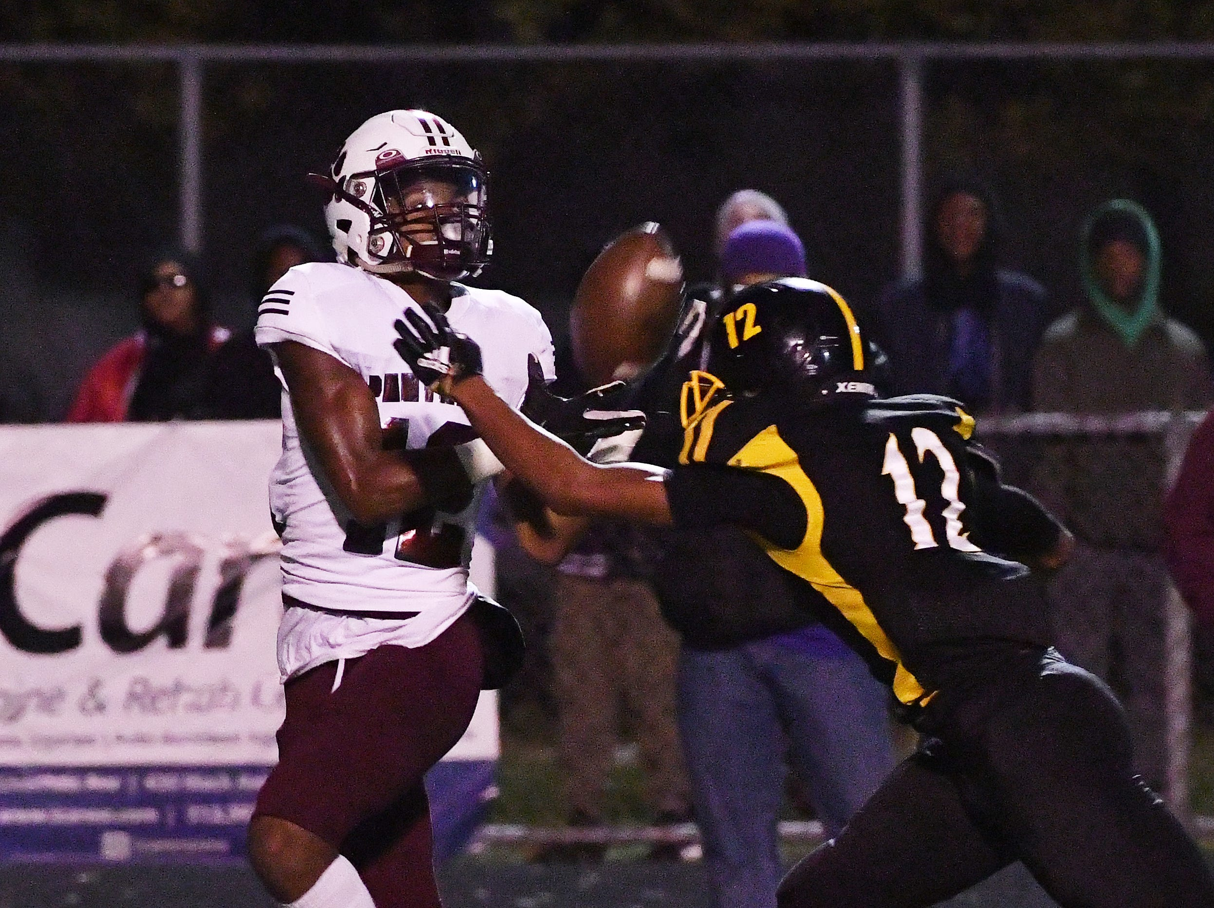 Rouge's Chrystenn Cochran brings in a long reception in front of King's Joe Frazier in the fourth quarter.