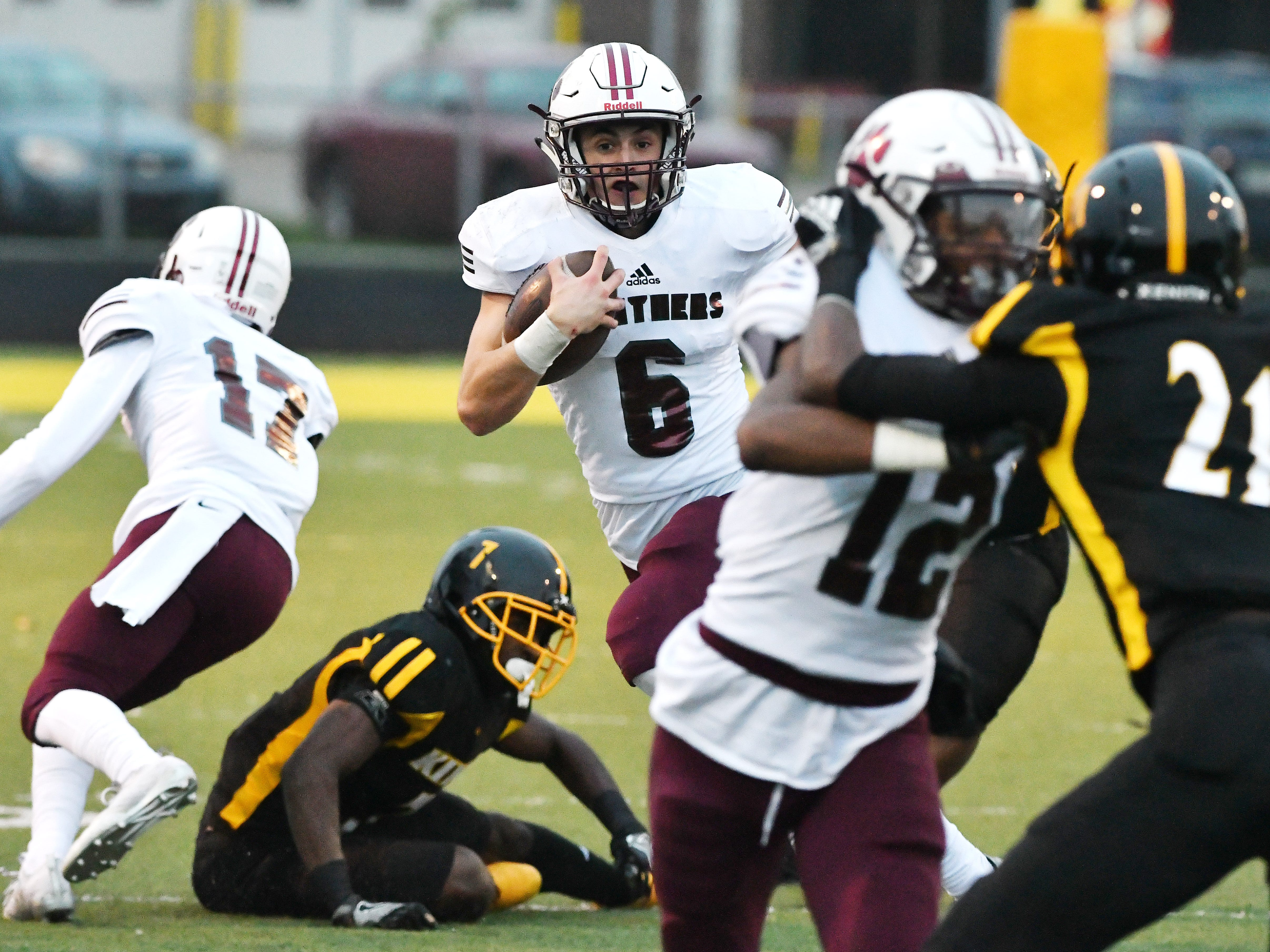 River Rouge quarterback Emmanuel Ferguson looks for a hole in King's defense in the second quarter.