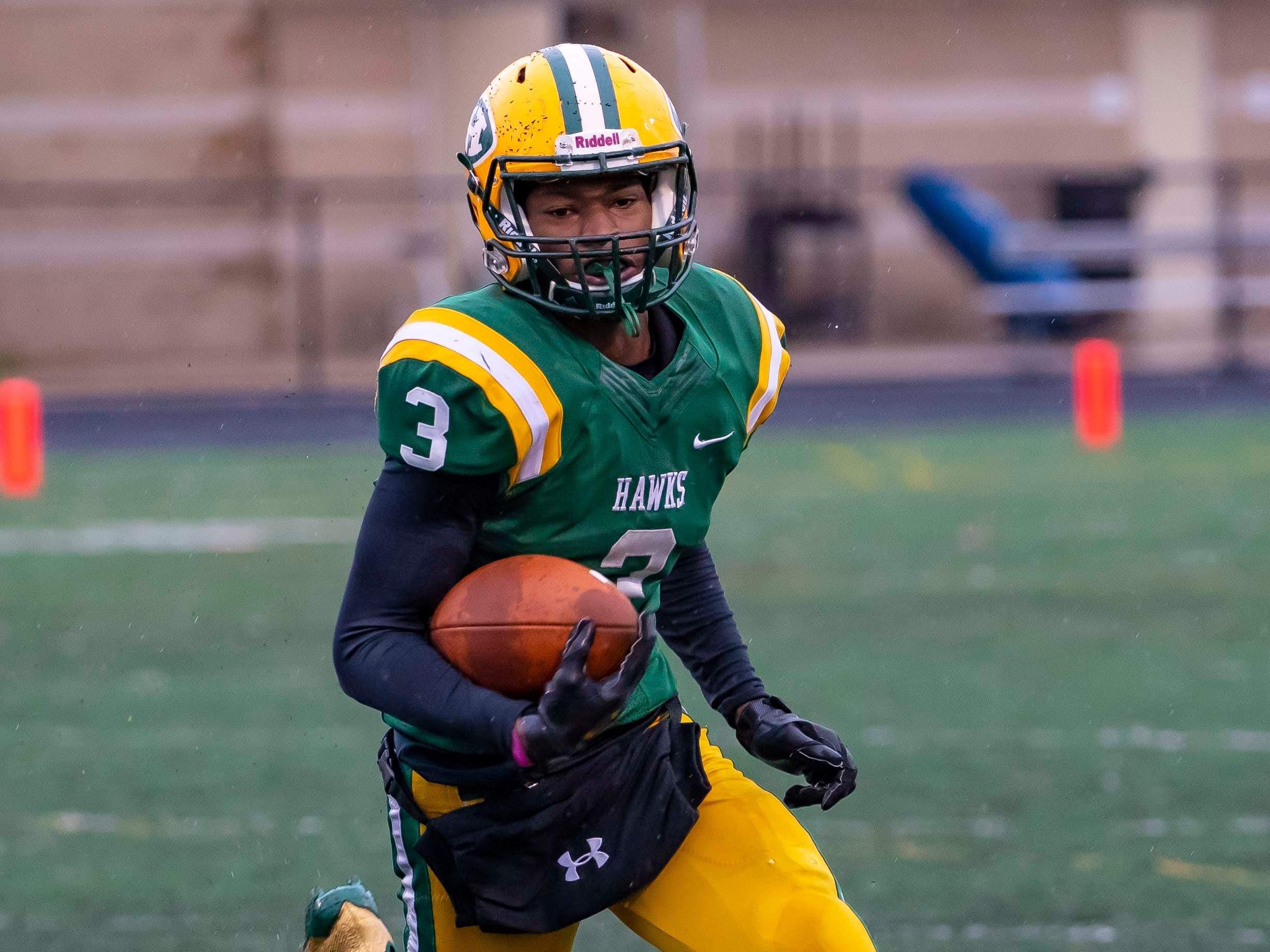 Roderick Heard (3) of Farmington Hills Harrison runs with the football in the second half.