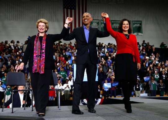 Sen. Debbie Stabenow, D-Lansing, left, former President Barack Obama and gubernatorial candidate Gretchen Whitmer appear at a rally at Cass Technical High School in Detroit, Michigan on Friday, Oct. 26, 2018.