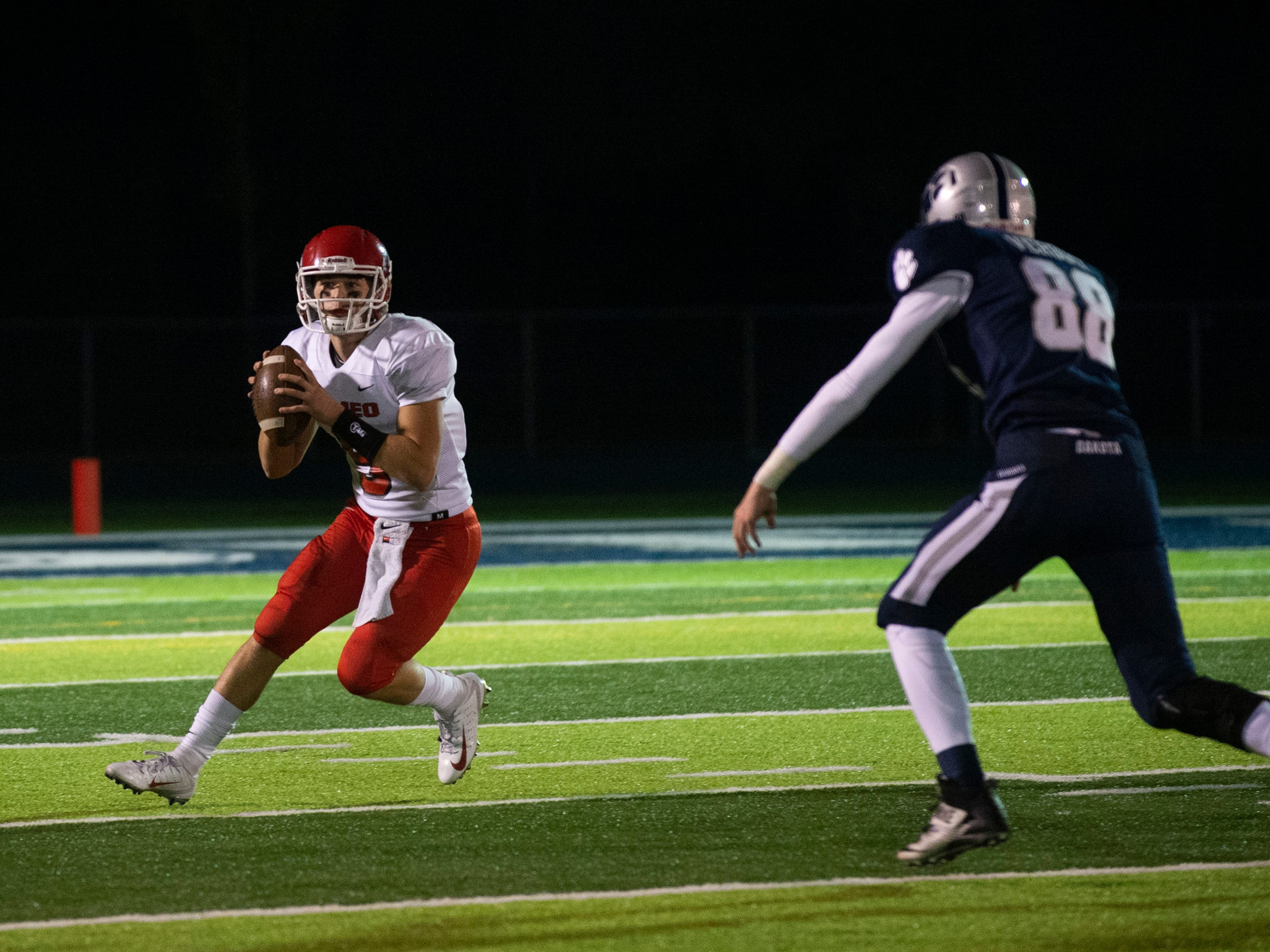 Romeo's Quarterback Jack Wendt looks to throw the ball during the 2nd quarter.